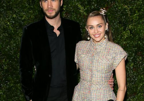 <p>Miley Cyrus and Liam Hemsworth attend a Chanel dinner in LA.</p>