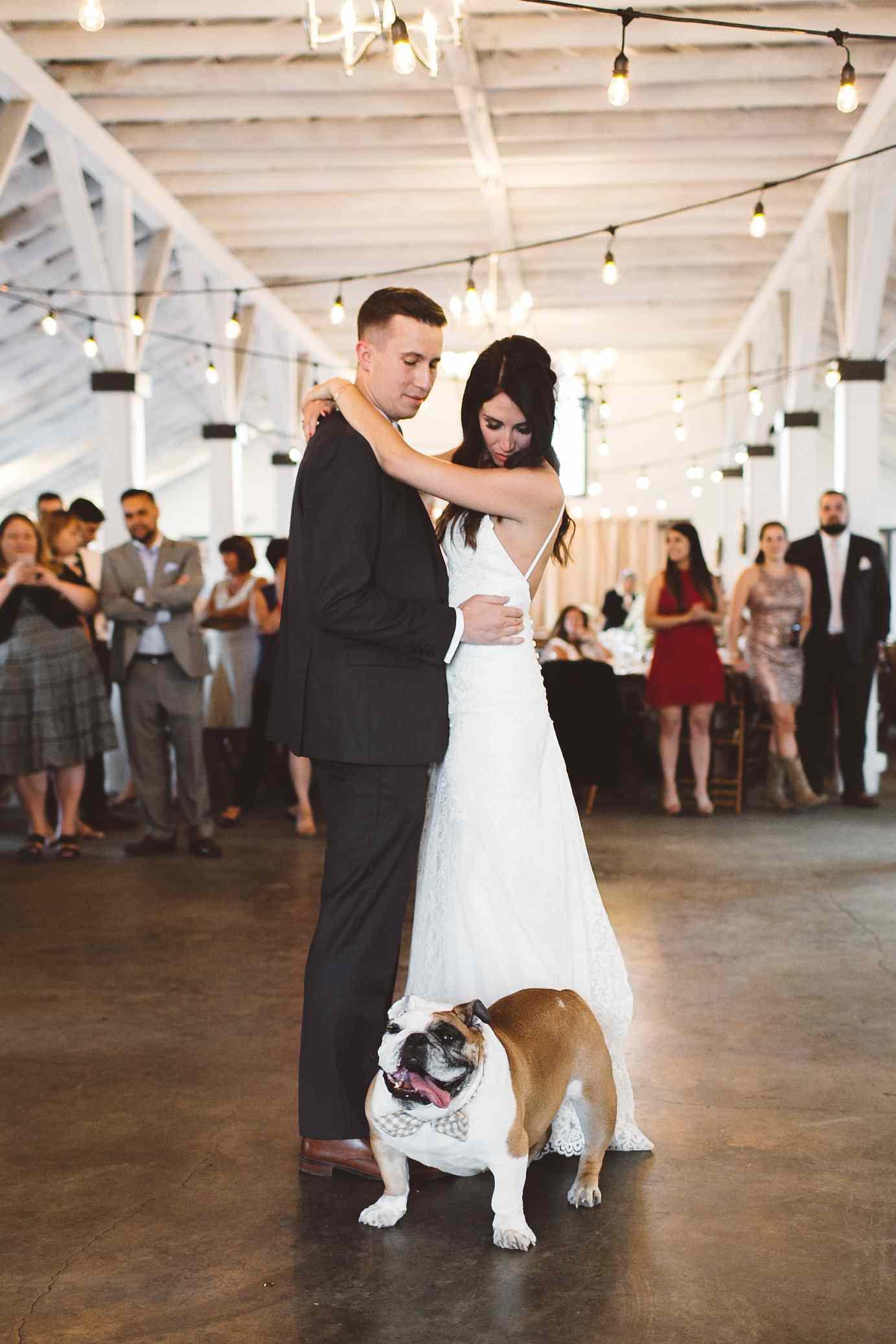 Newlyweds dancing with dog