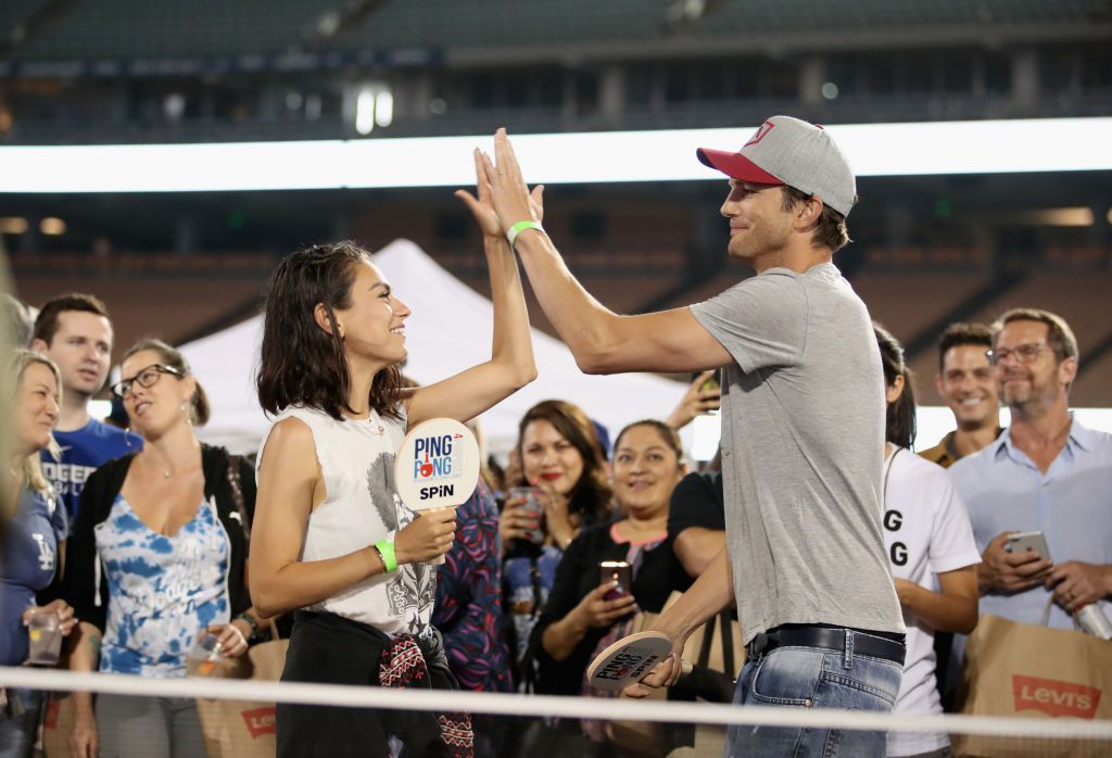 Mila Kunis and Ashton Kutcher play ping pong at Clayton Kershaw's 6th Annual Ping Pong 4 Purpose on August 23, 2018 in Los Angeles, California.