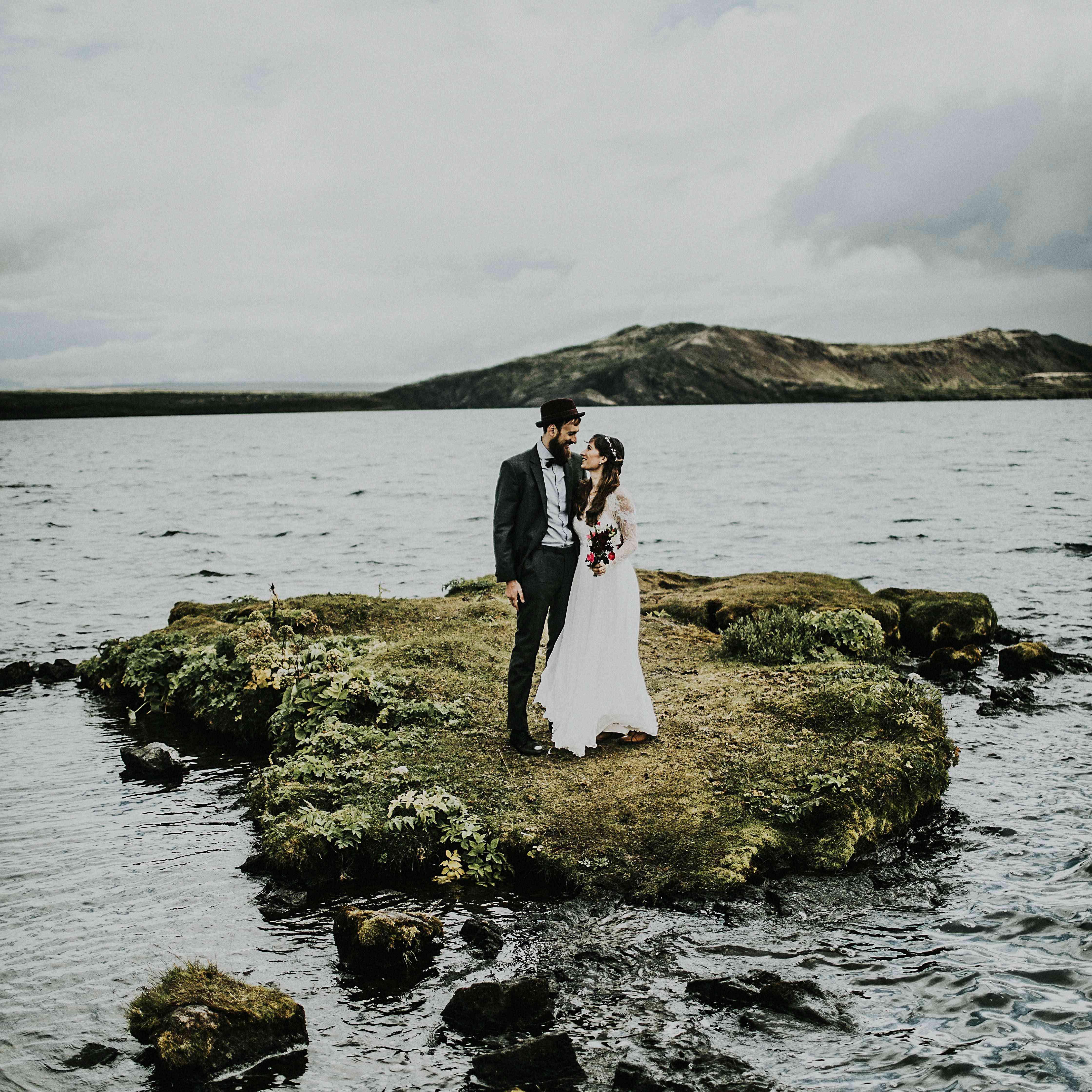 Couple hugging on a mini island in Island