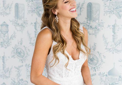 <p>bride in wedding dress long hair hair down</p>