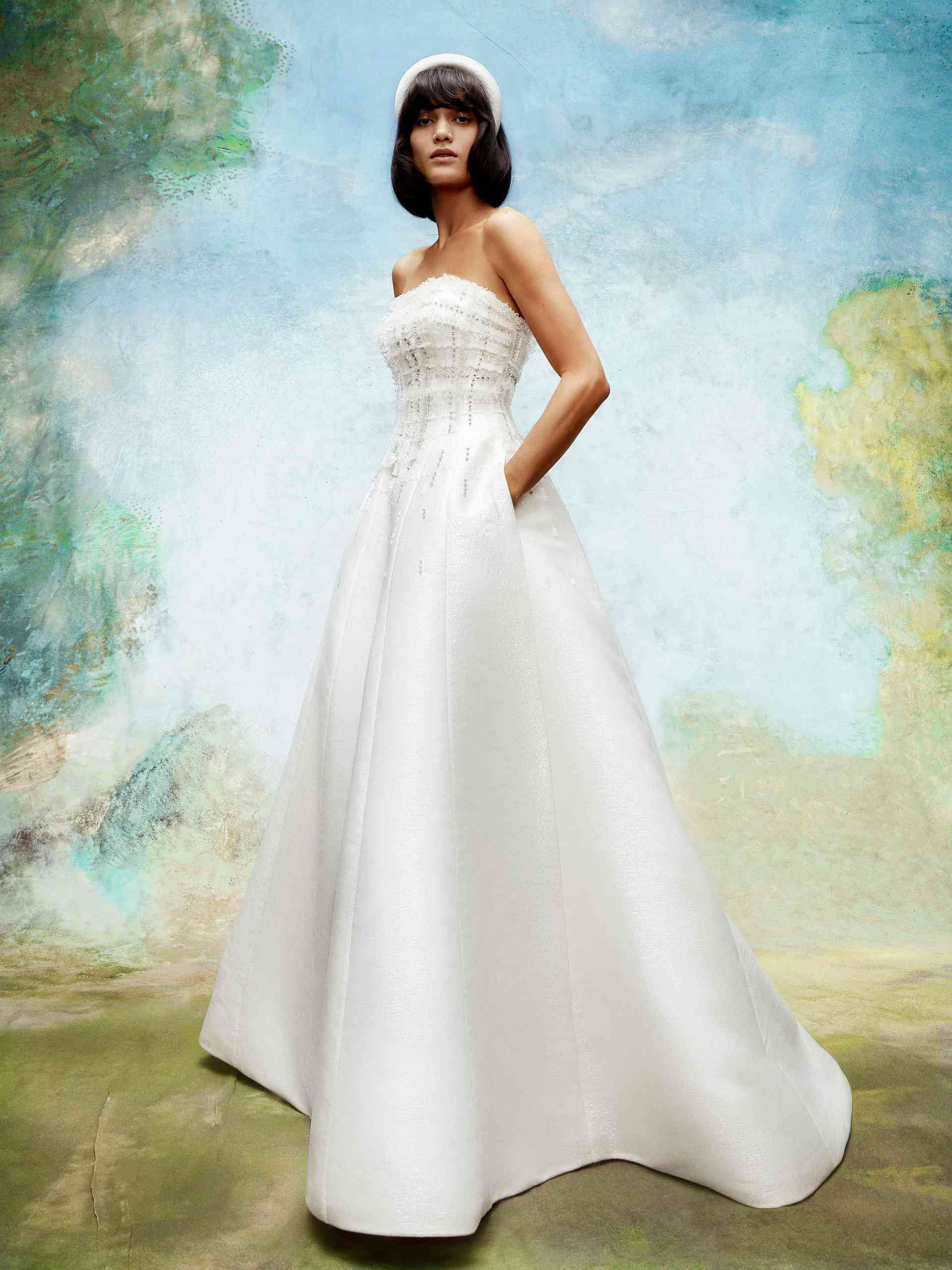 Model in strapless white wedding gown with pockets