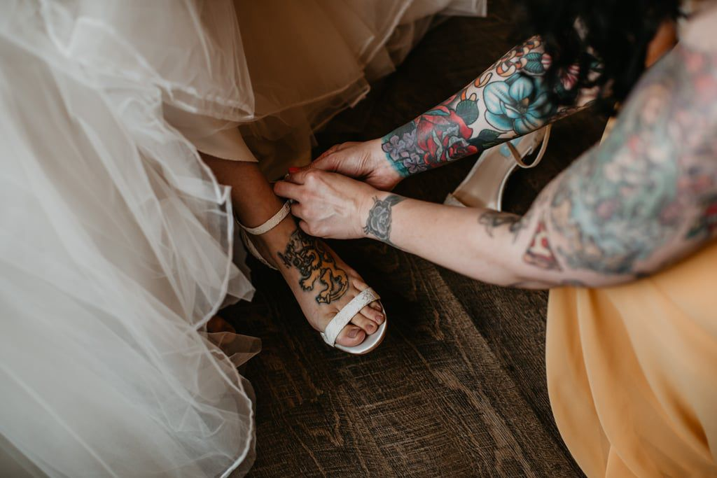 Bride with a foot tattoo getting ready