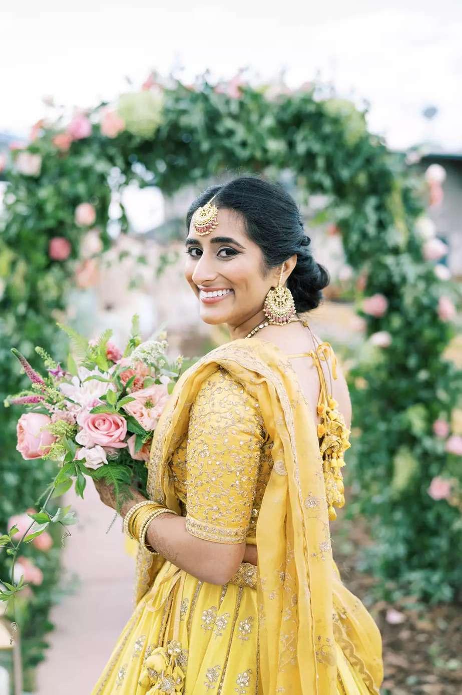 Bridesmaid in yellow lengha