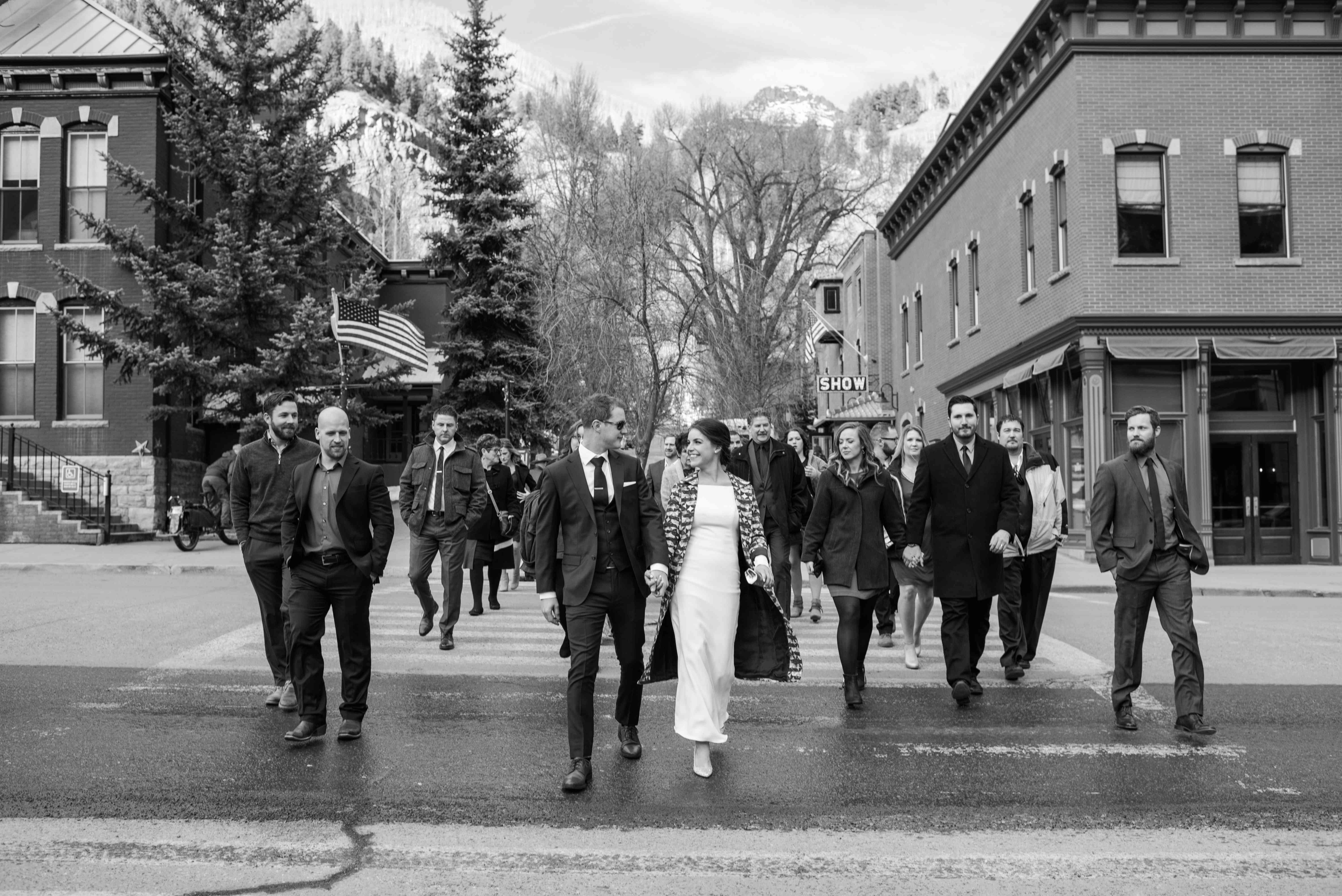 bride and groom walking with guests