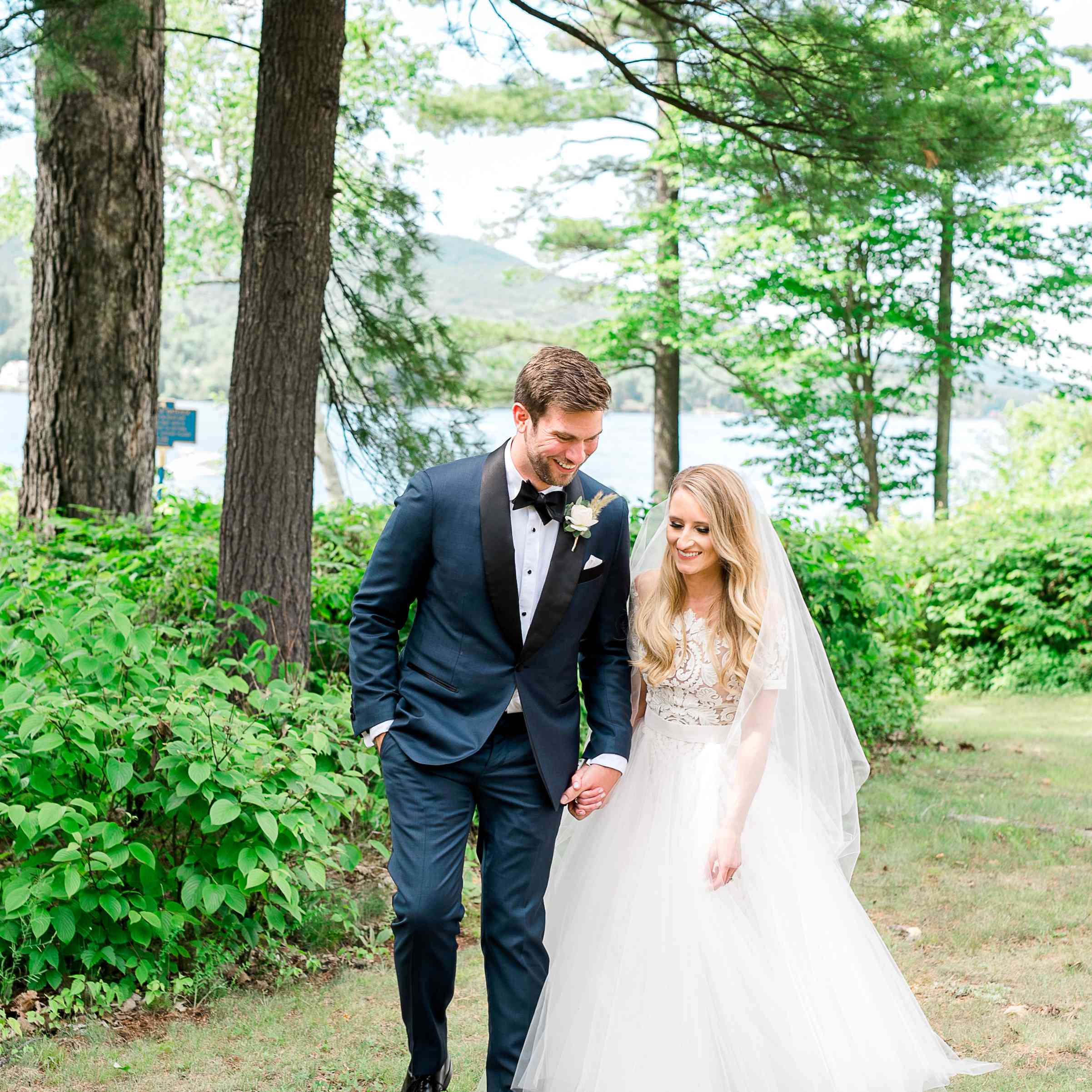 <p>Bride and groom holding hands</p><br><br>