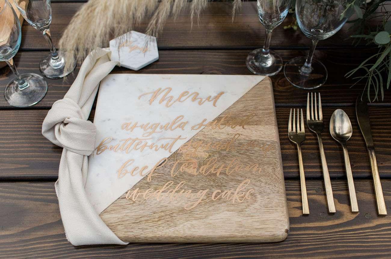 Wedding Menu Written on Cutting Board