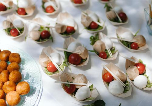 Caprese appetizers and risotto balls at wedding reception