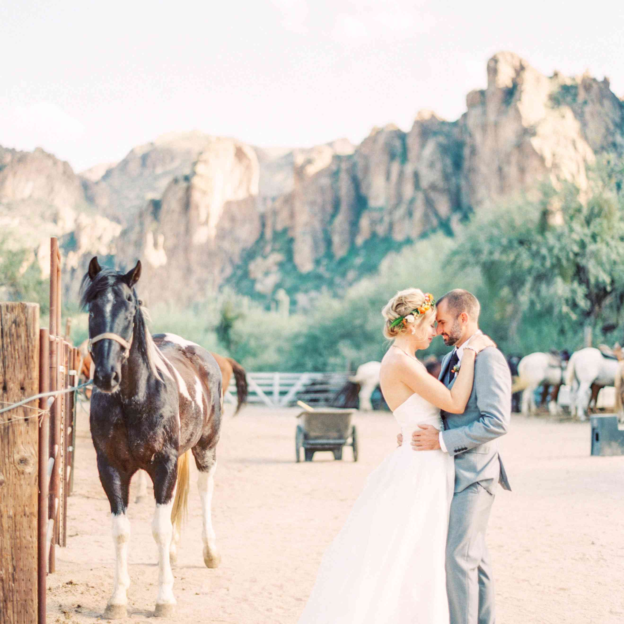 Couple posing with horse and mountains in the background