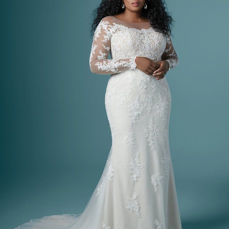 Plus size model in illusion bateau and sleeves wedding gown