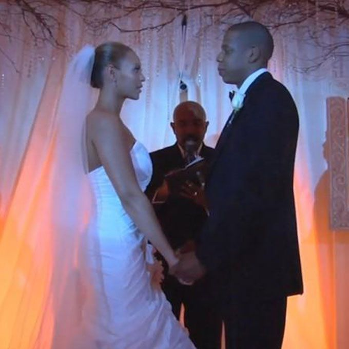 Beyoncé marries Jay-Z in a white strapless sweetheart gown, 2008