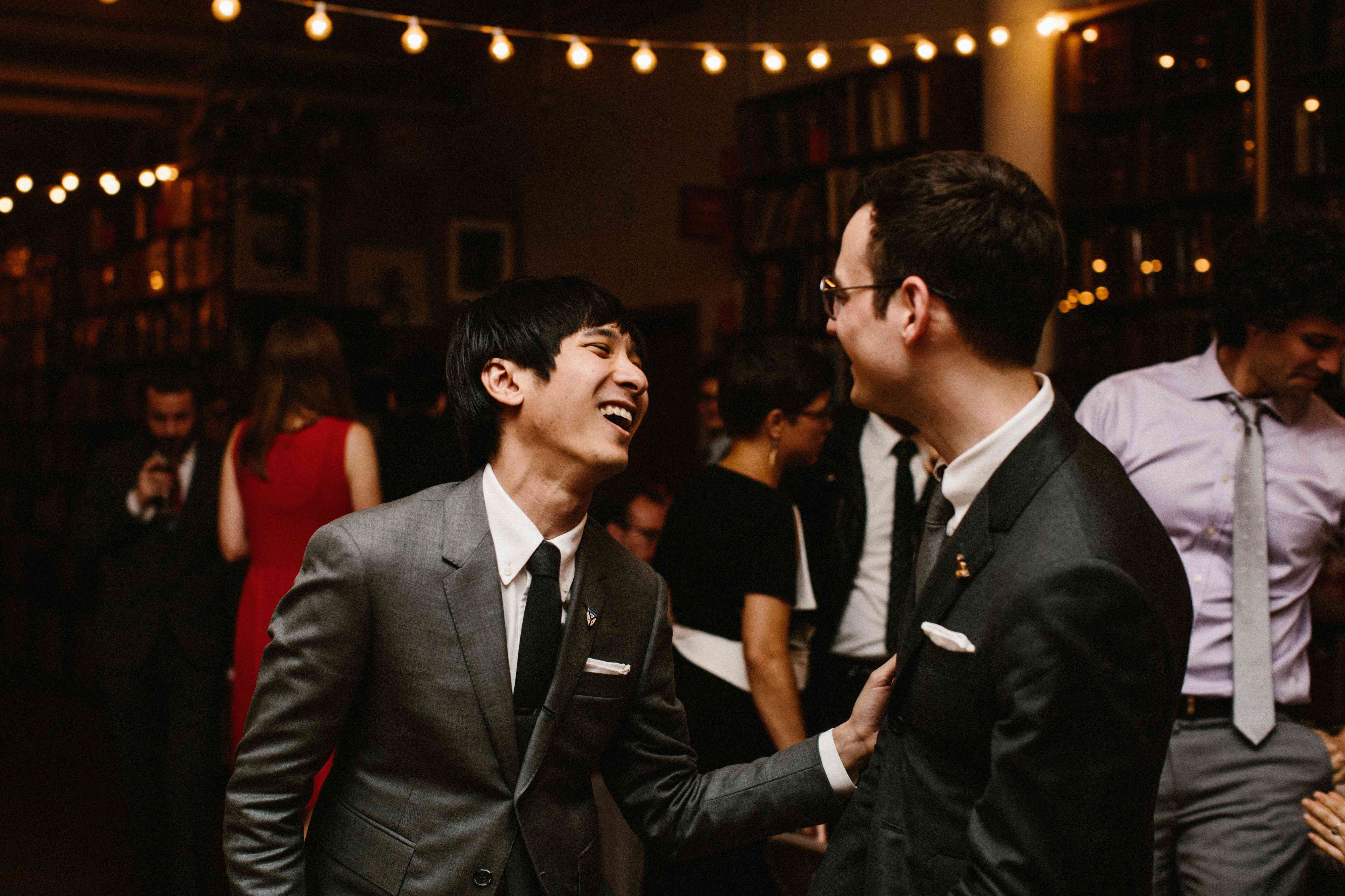 Grooms laughing