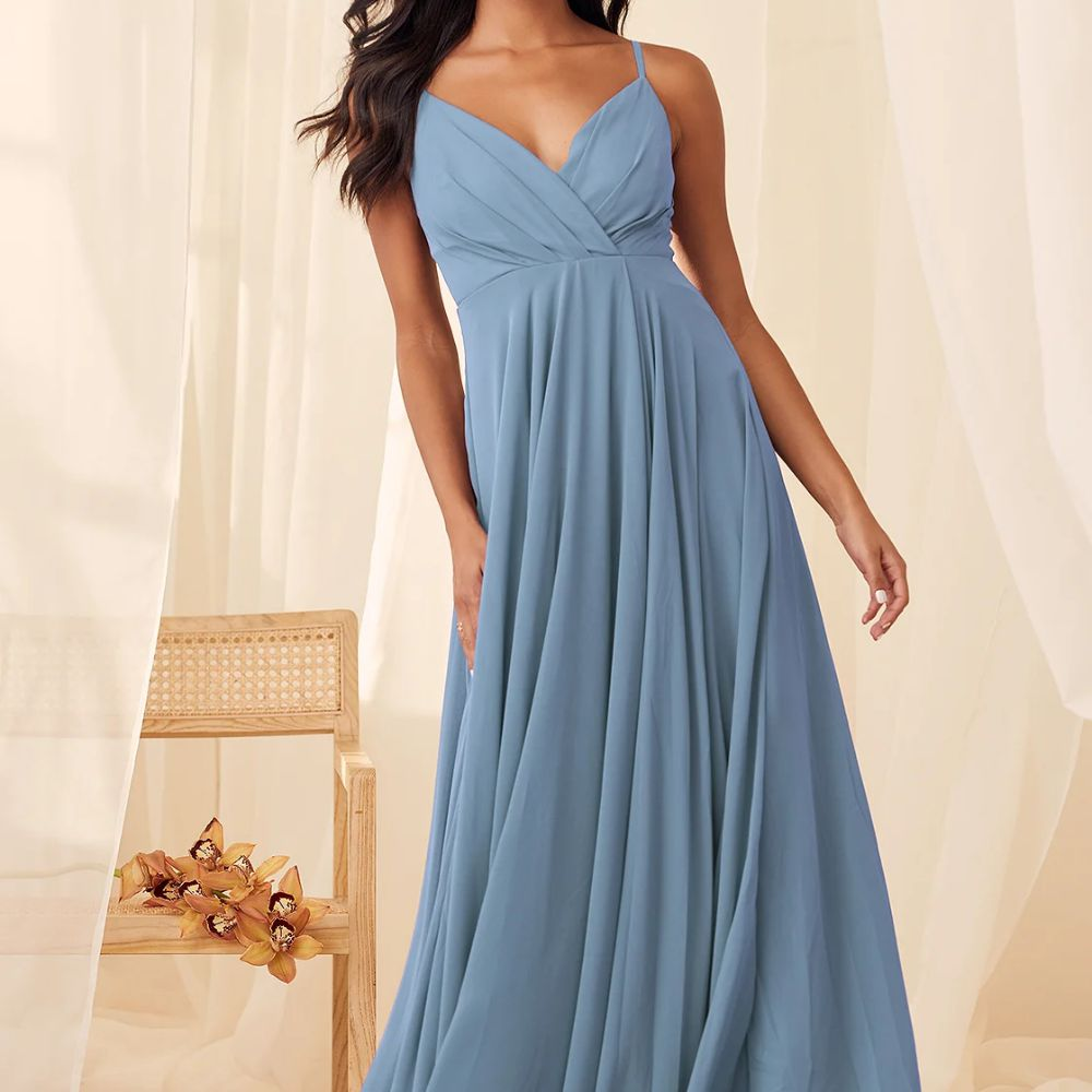 Model in a V-neck sleeveless light blue gown with a cascading skirt