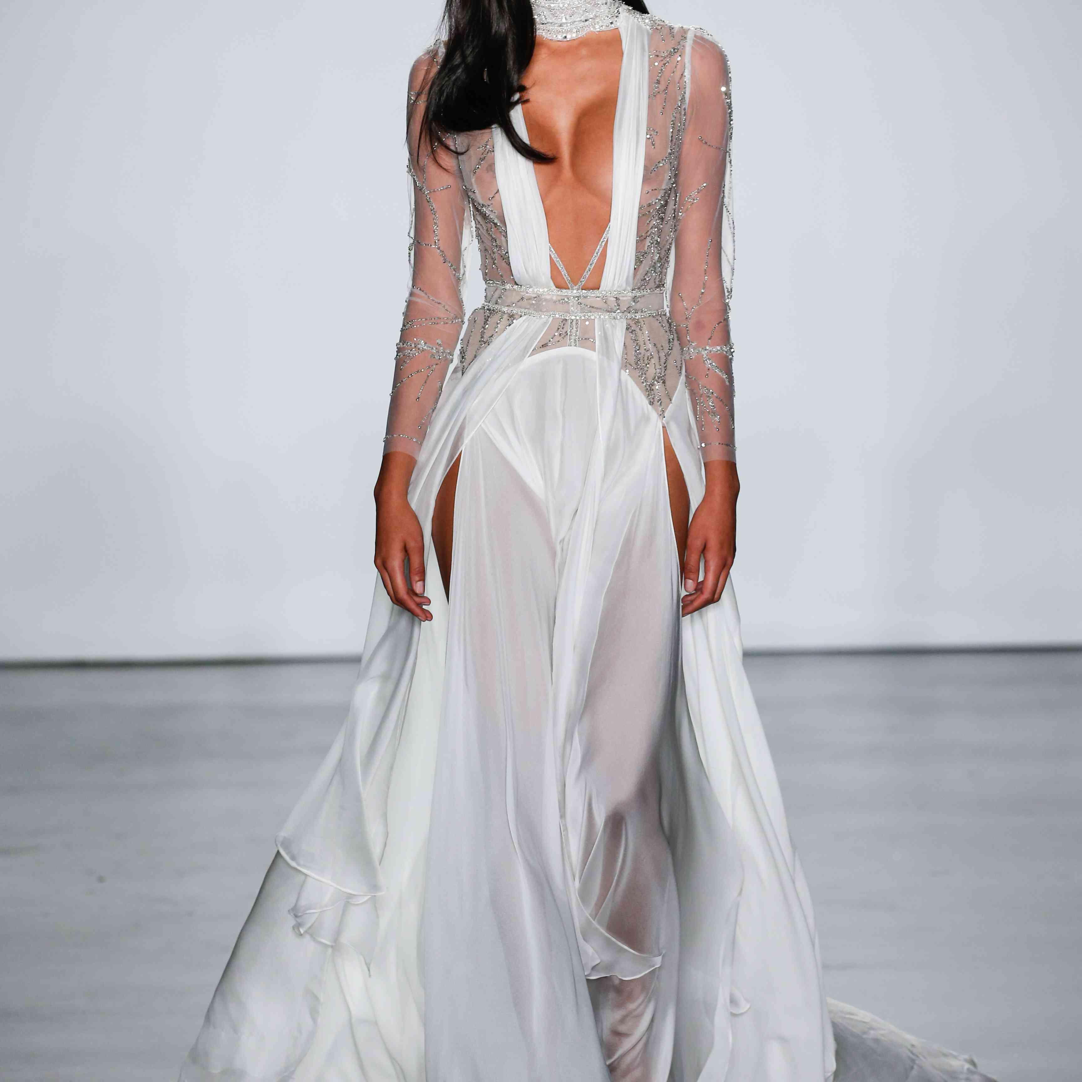 Model in plunging long sleeve wedding dress