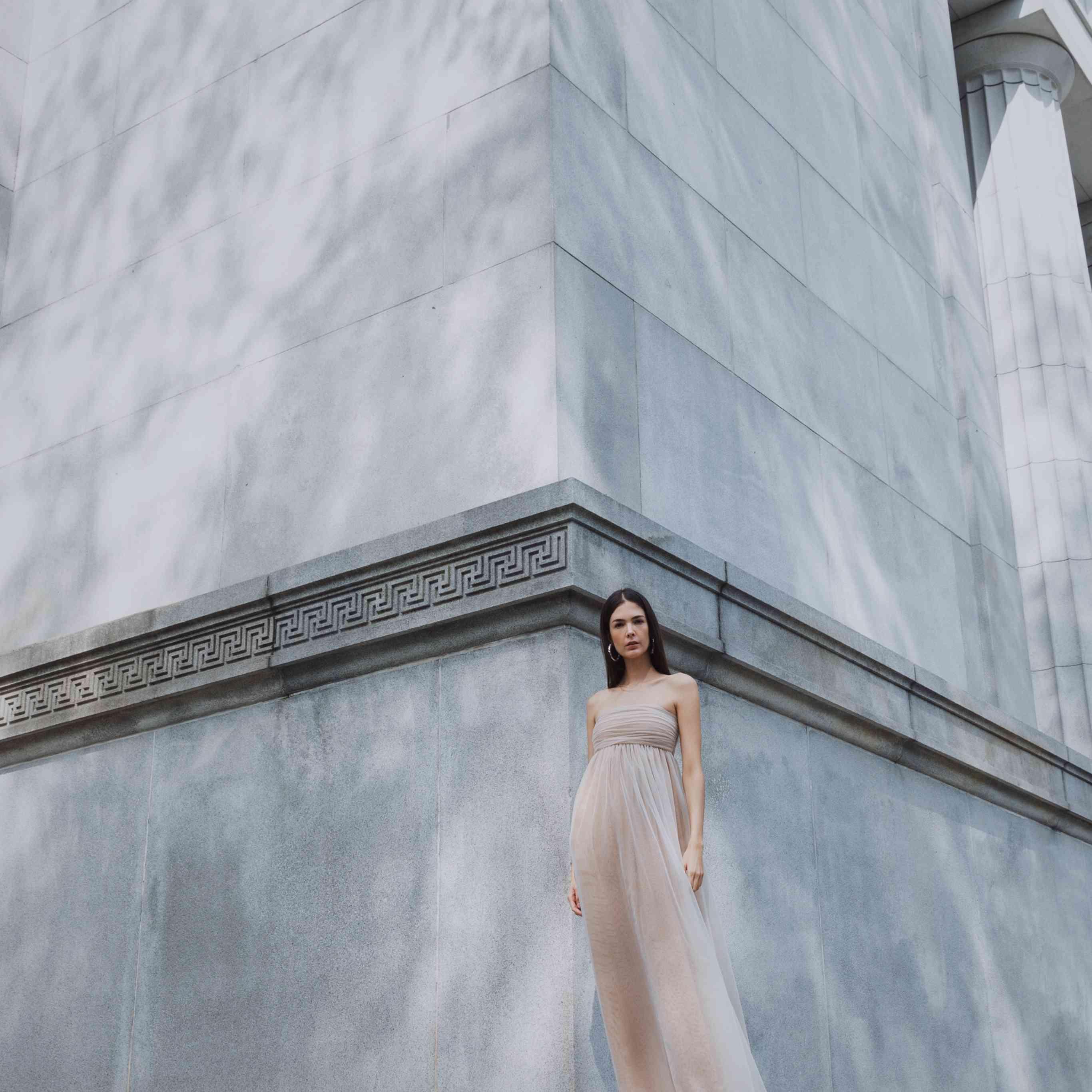 Model in strapless wedding dress with empire waist