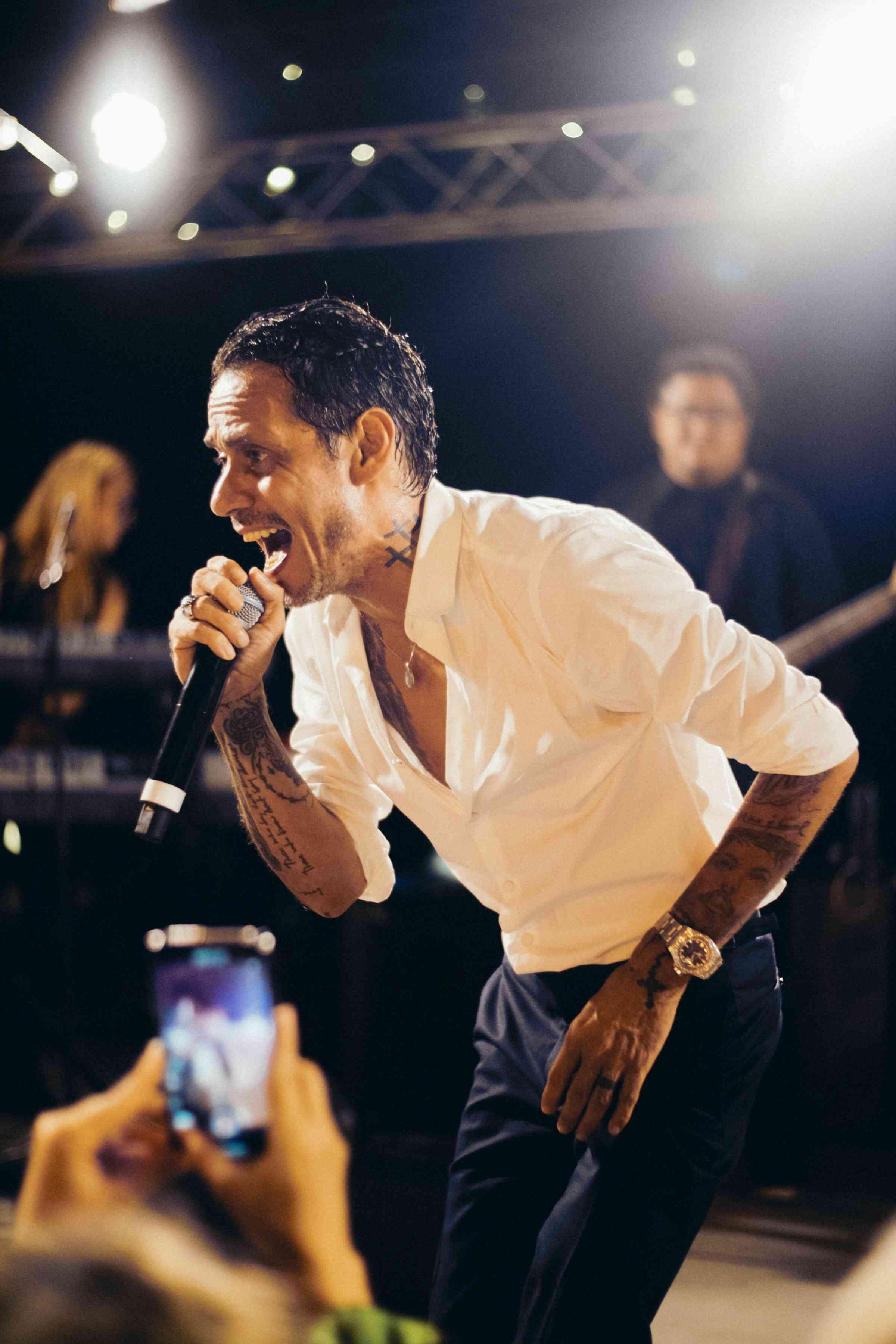 Marc Anthony singing at reception