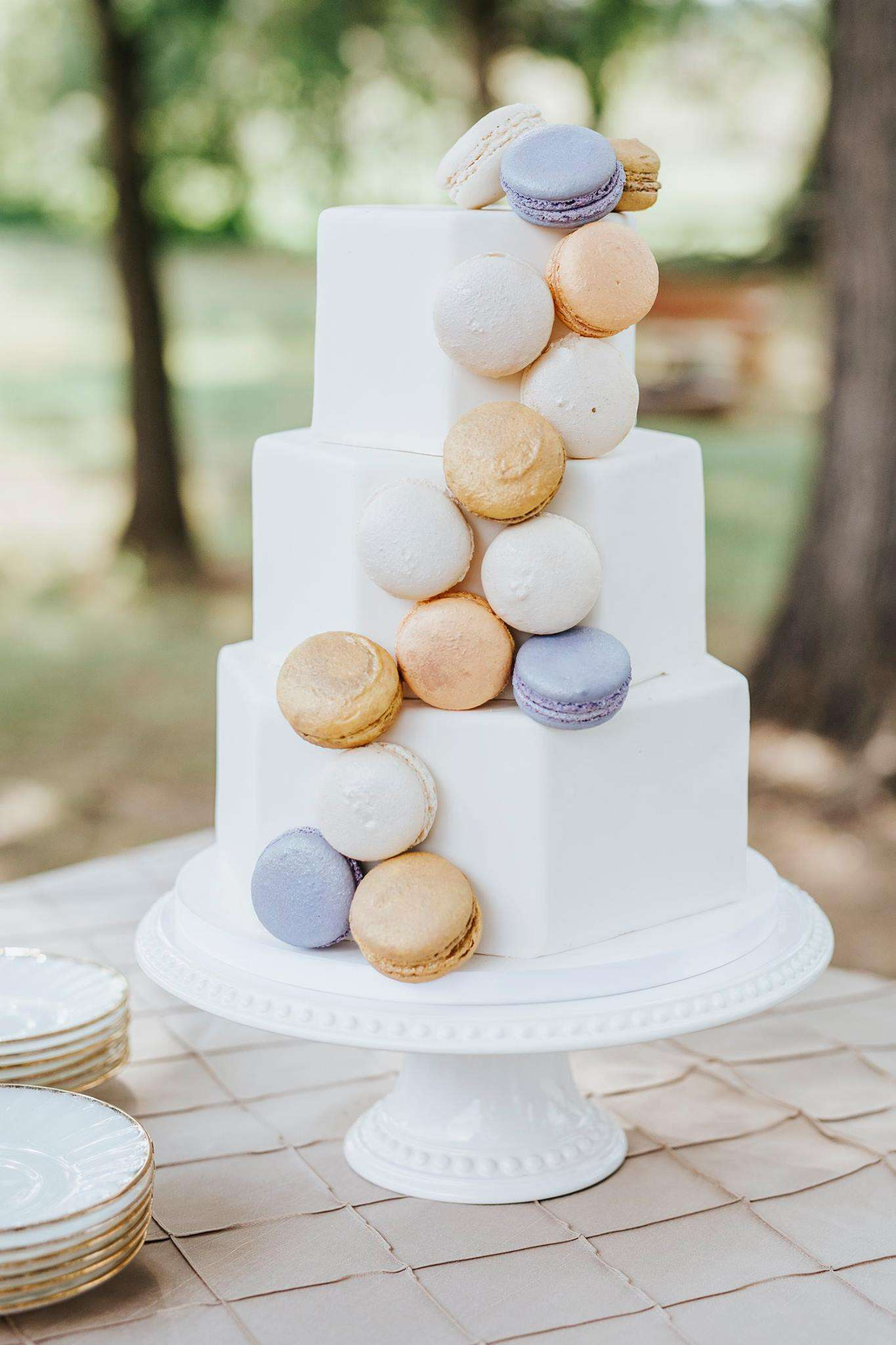 tiered cake with macarons