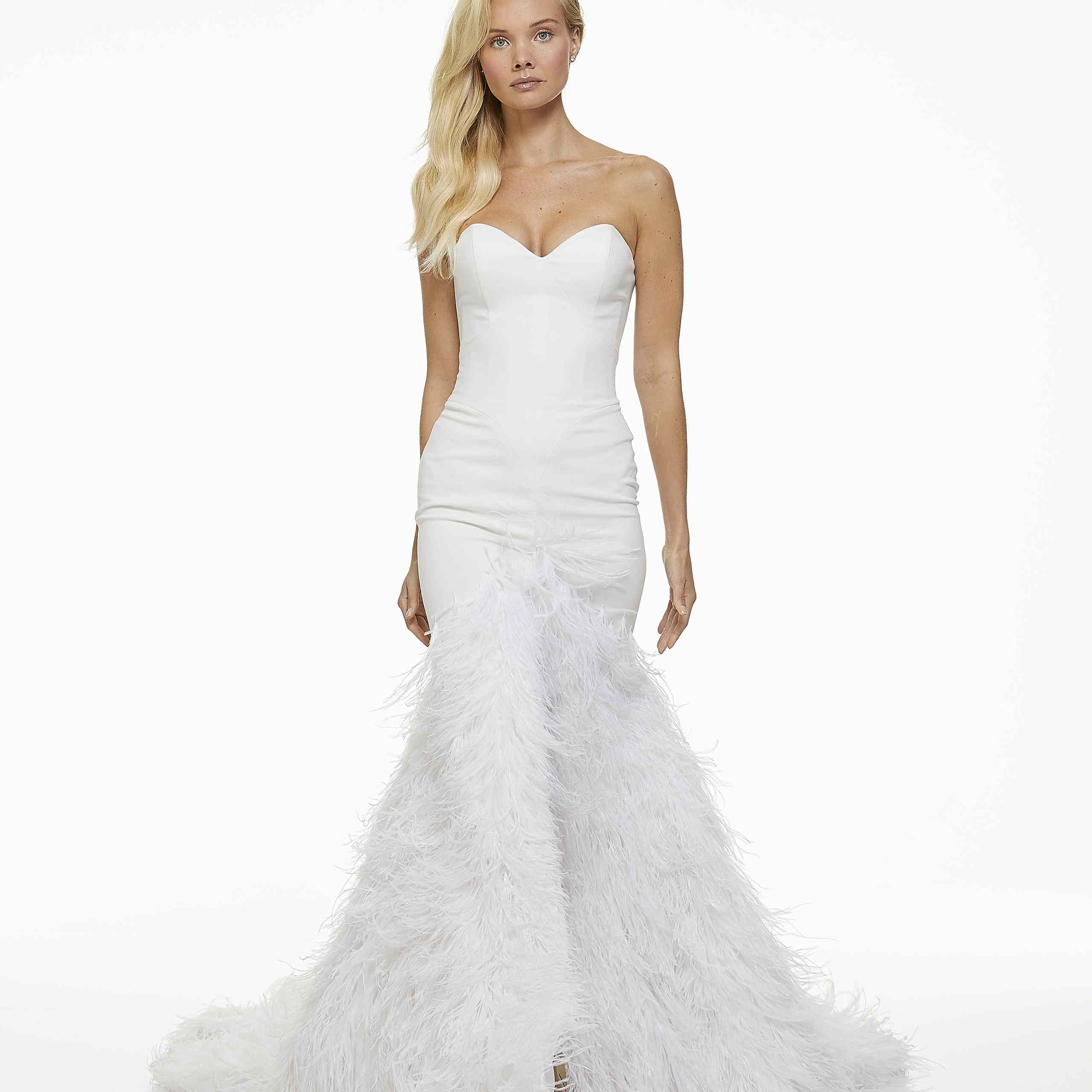 Model in strapless sweetheart wedding dress with feathers
