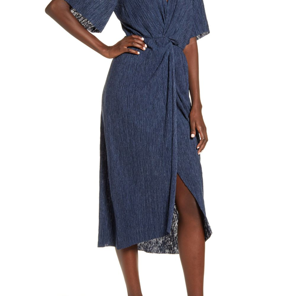 Model in a royal blue wrap dress