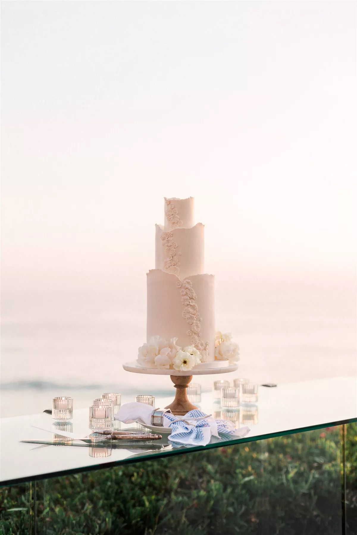 wedding cake on display by the ocean