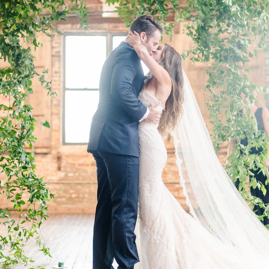 <p>Bride and groom kissing at ceremony</p><br><br>