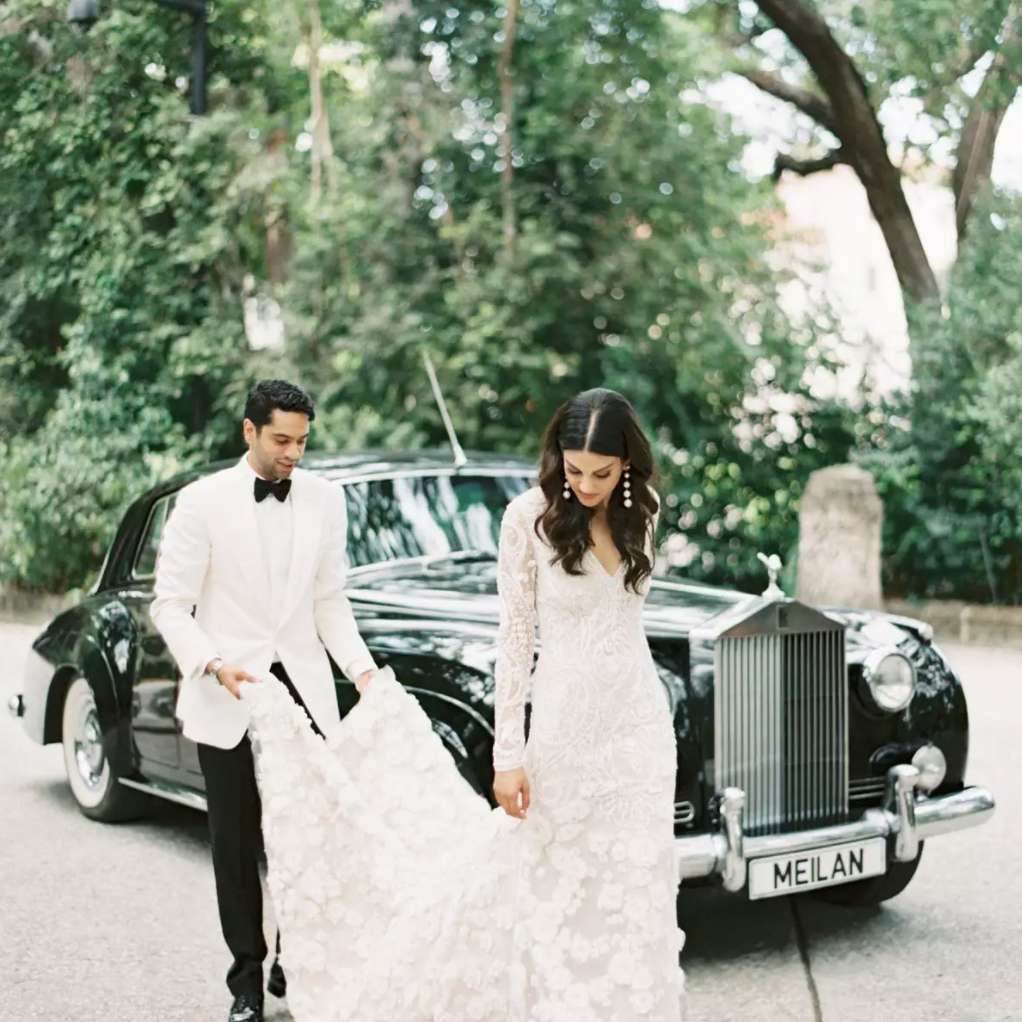 Newlyweds and vintage car