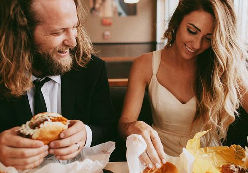 <p>couple eating burgers</p>