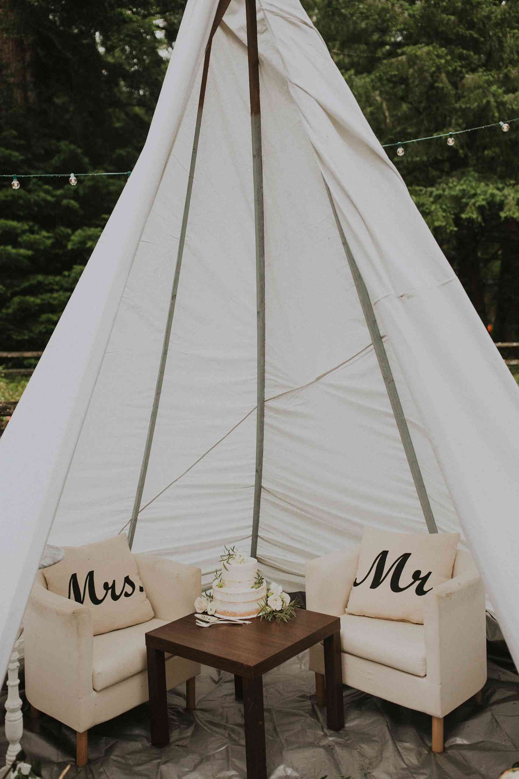 Tent and chairs with Mr. and Mrs. pillows.