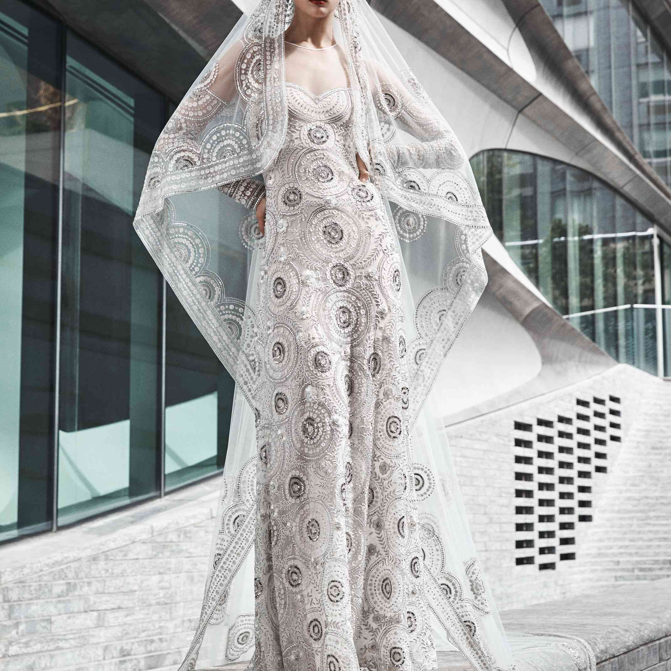 Model in gown with circular sequin embroidery