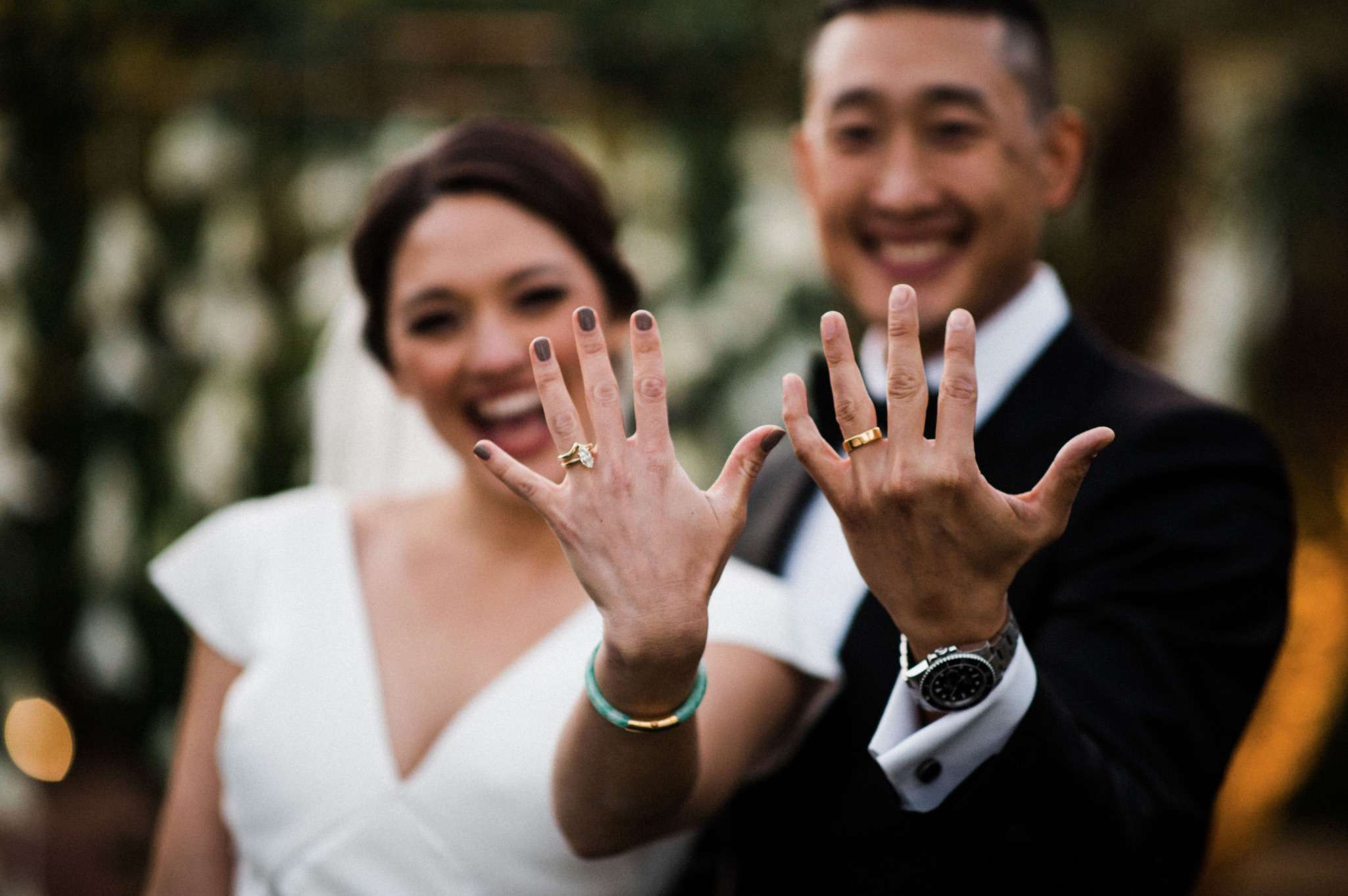 Newlyweds happily showing off rings