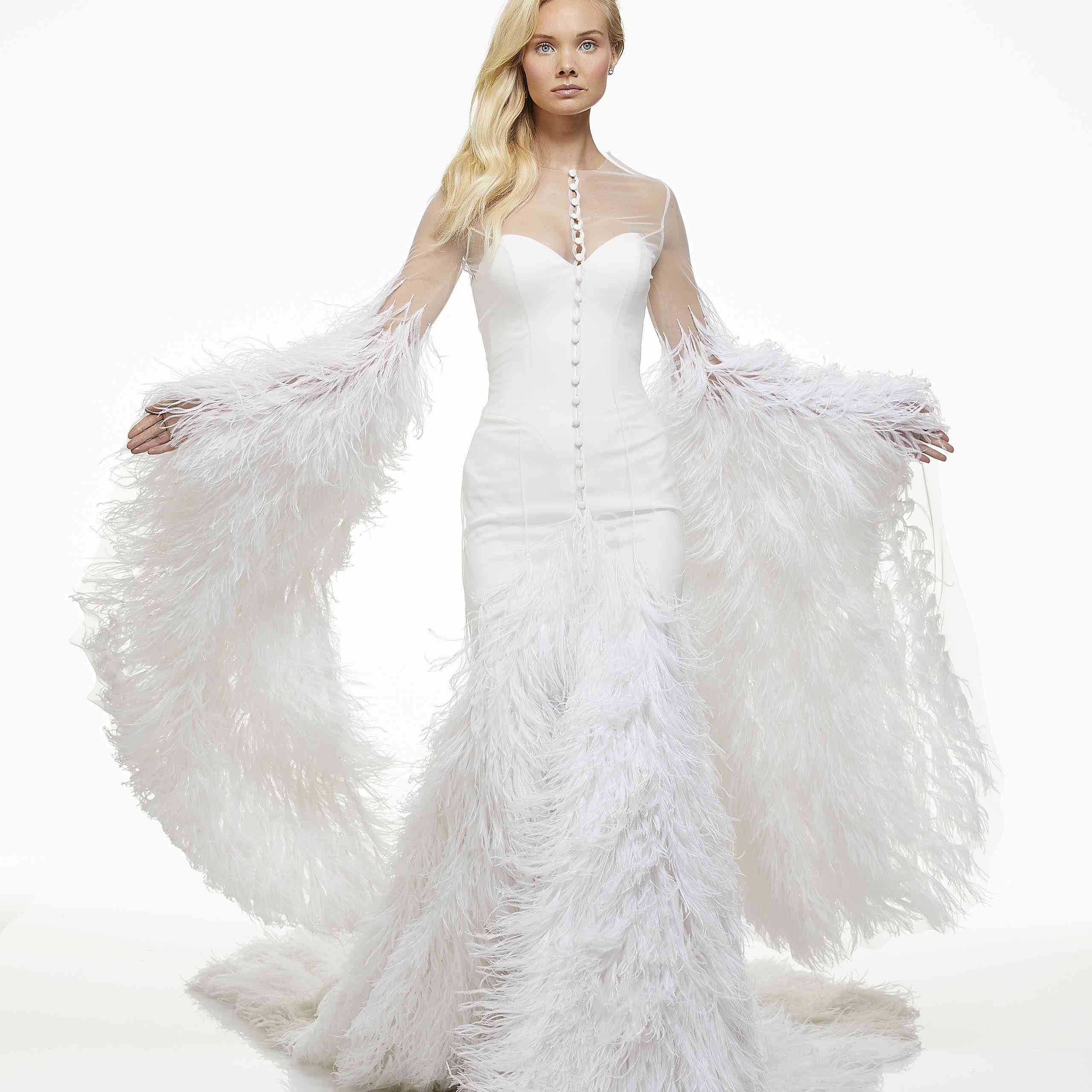 Model in long sleeve wedding dress with feathers