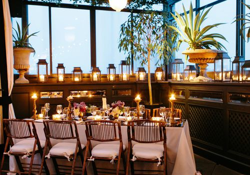 reception décor with plants and candles