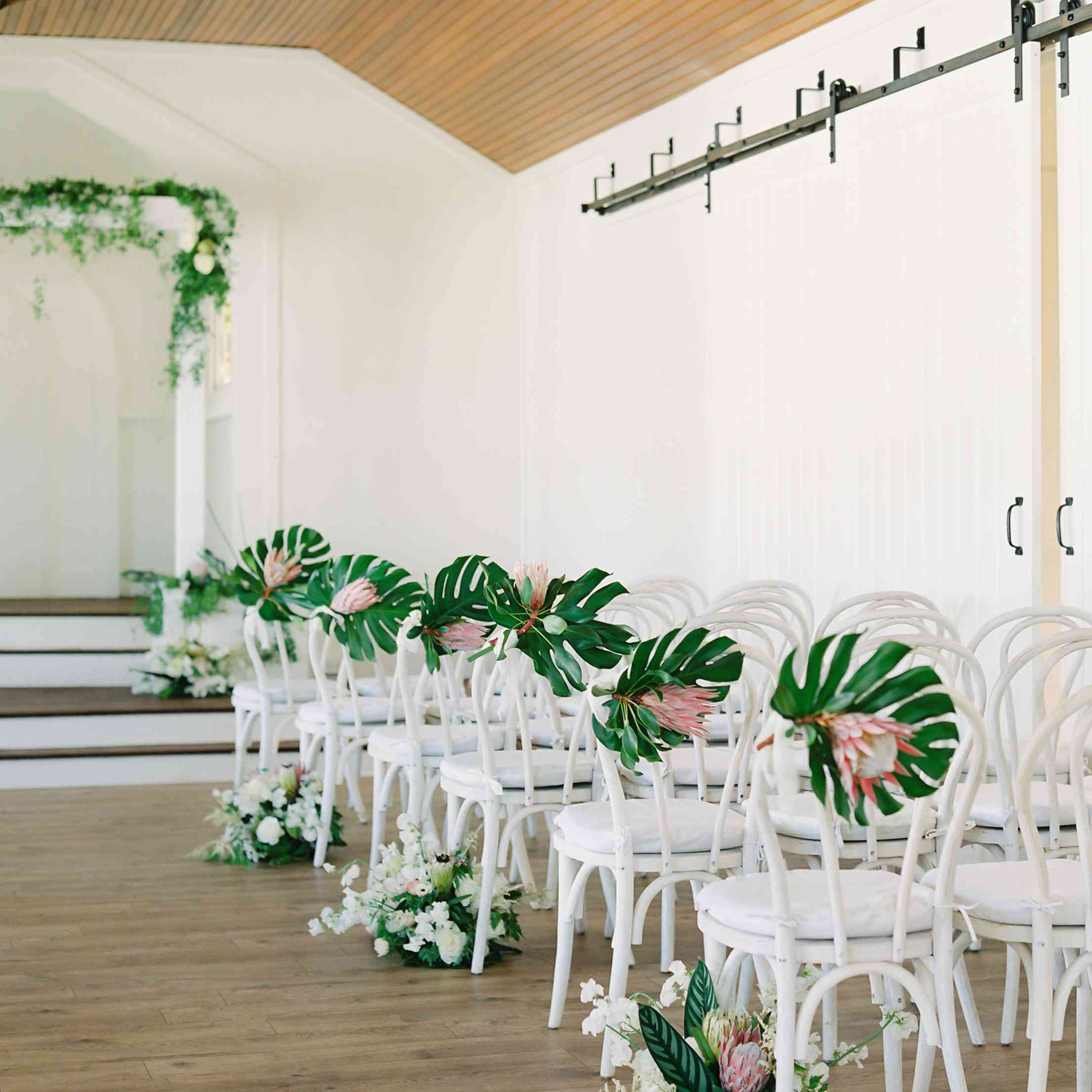 tropical maui wedding, white ceremony seating tropical flowers