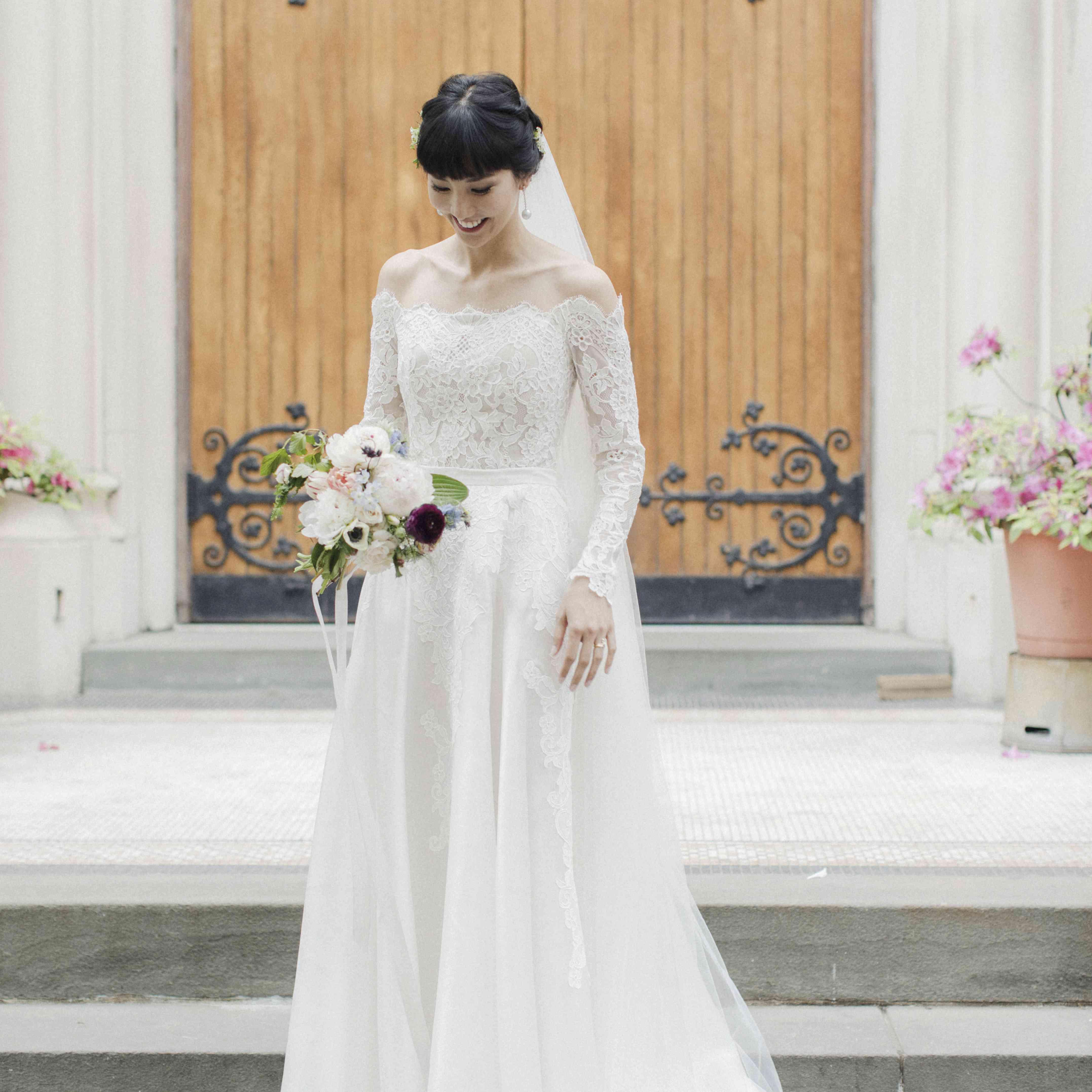 Bride in front of doors