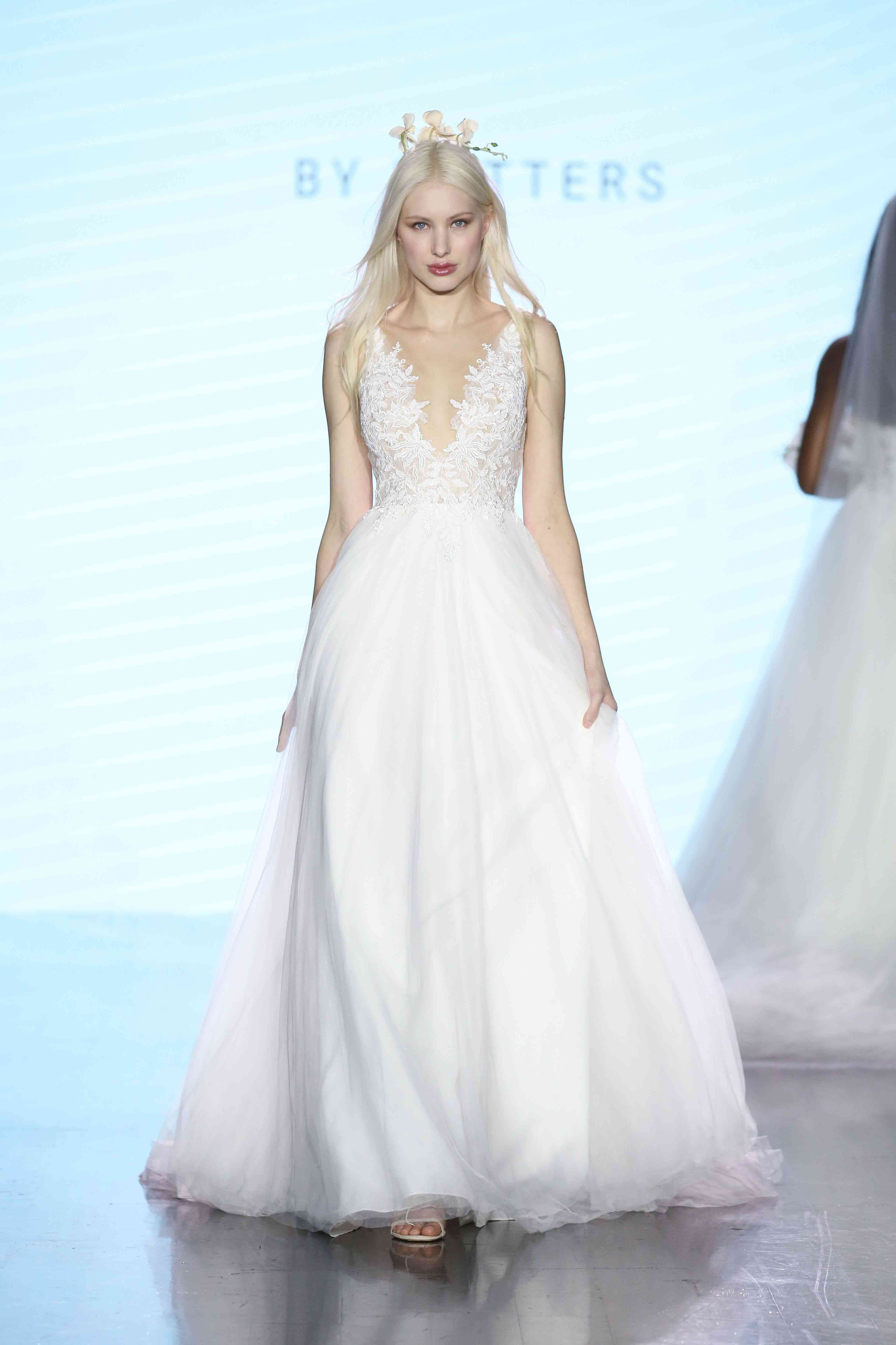 Model in ballgown with a lace-embroidered plunging illusion bodice and full skirt