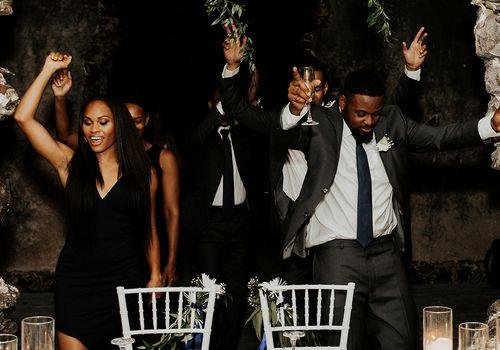 Bride and groom dancing behind dinner table
