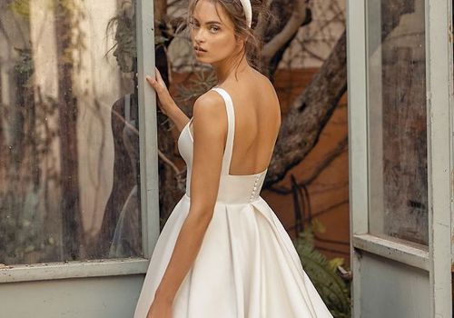 Model in strapless A-line wedding dress with headband