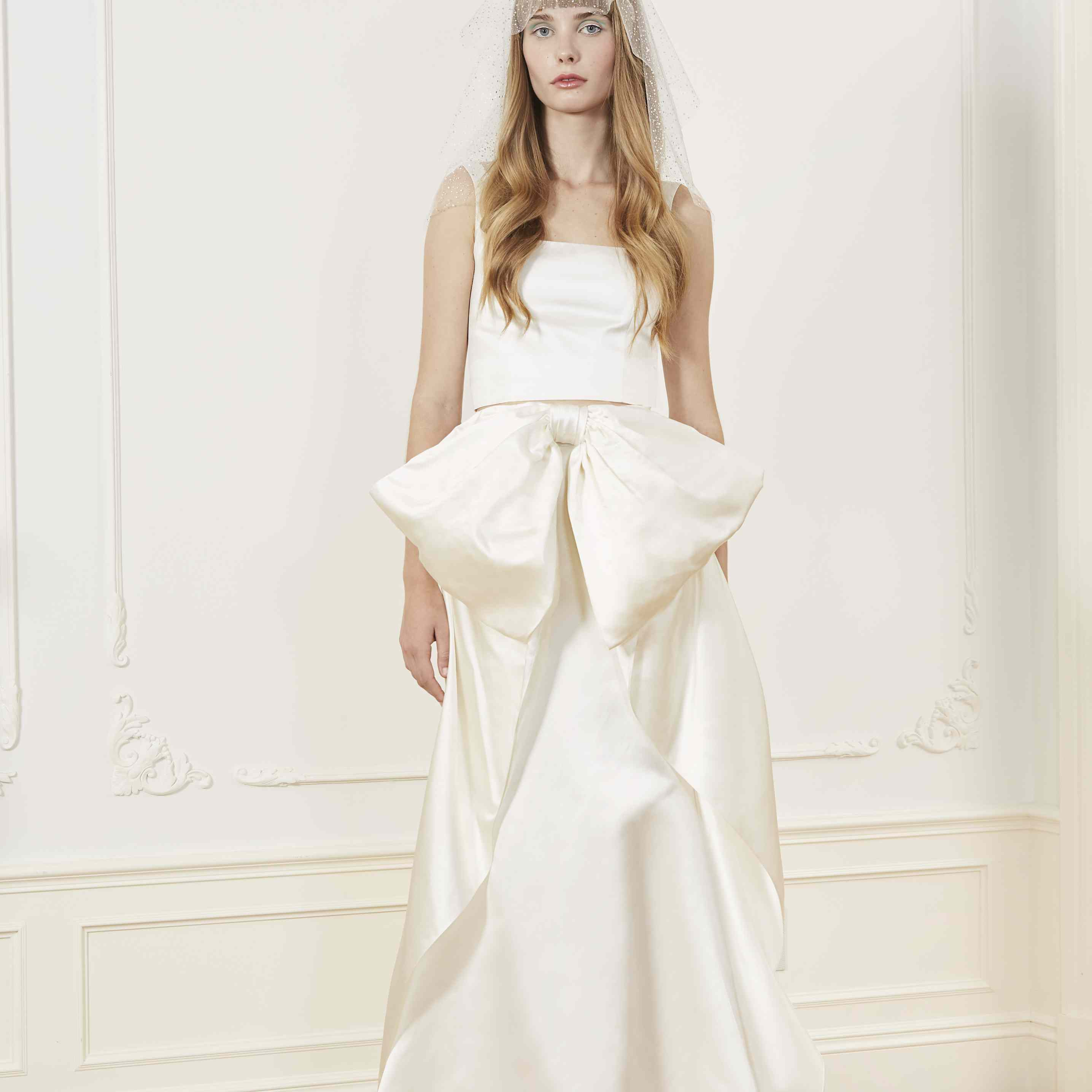 Model in two-piece wedding tank and skirt