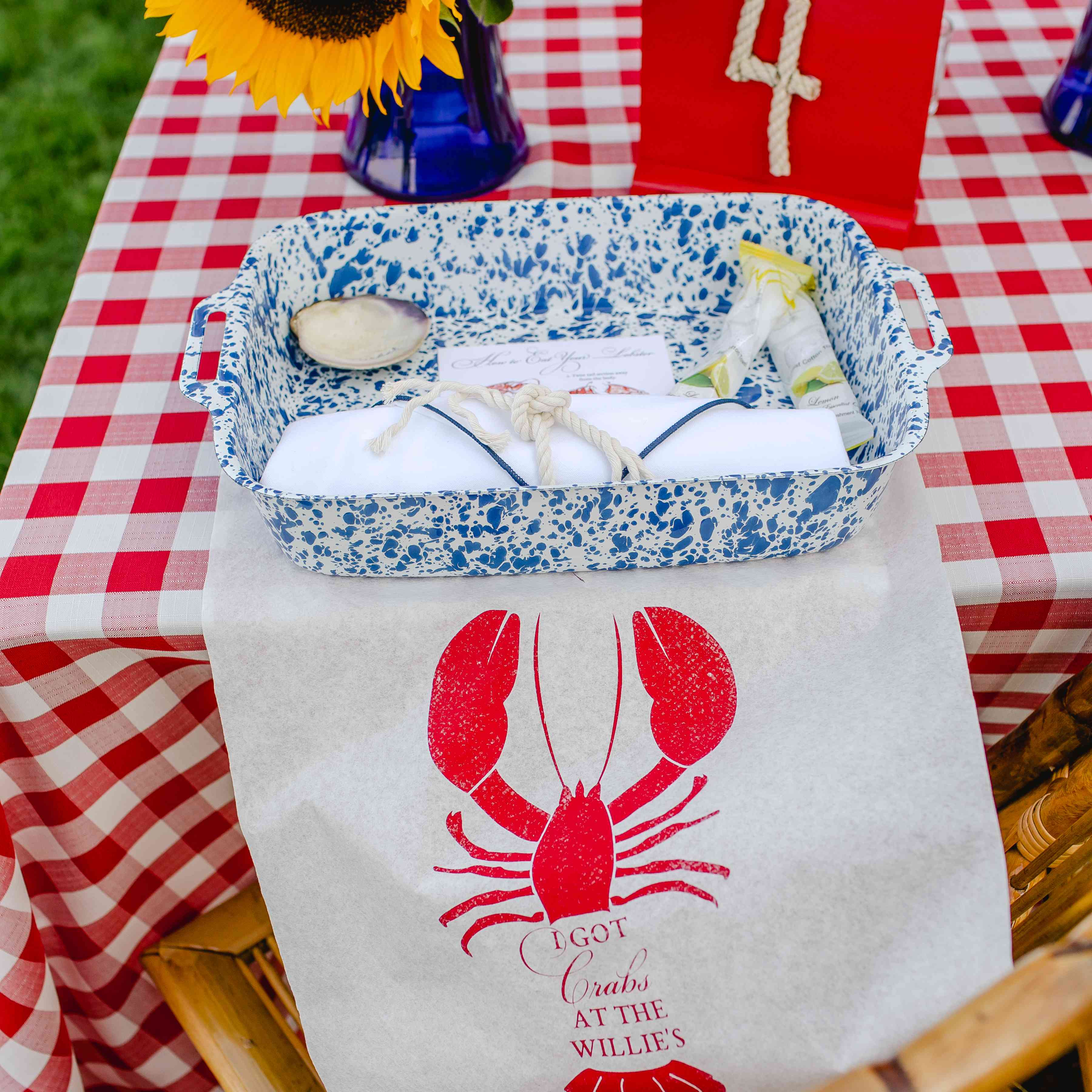 A place setting at an outdoor clam bake rehearsal dinenr