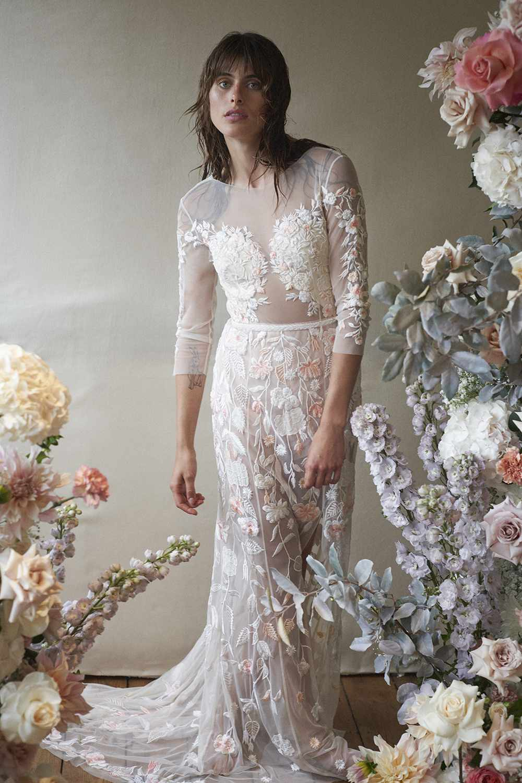 Model in three-quarter-sleeve wedding dress