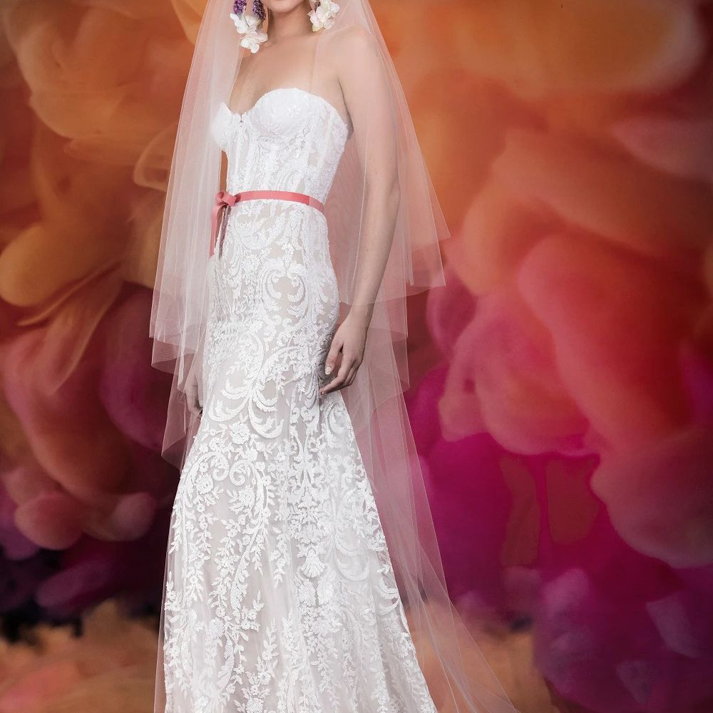 Model in allover lace strapless gown