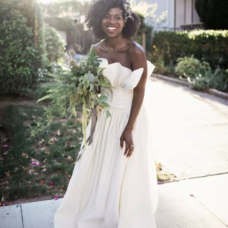 bride in strapless gown with flowers