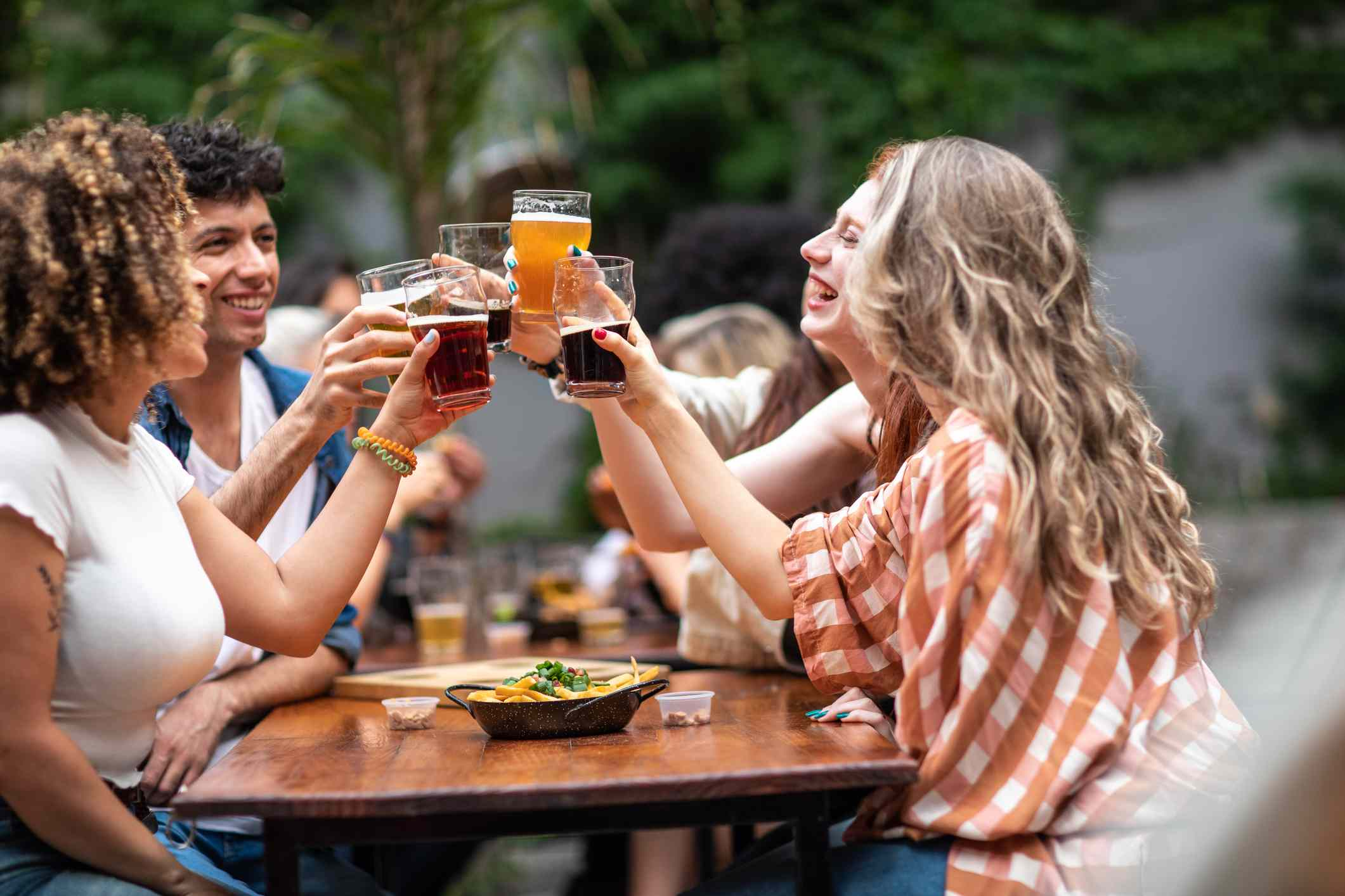 Friends toasting beer at a pub