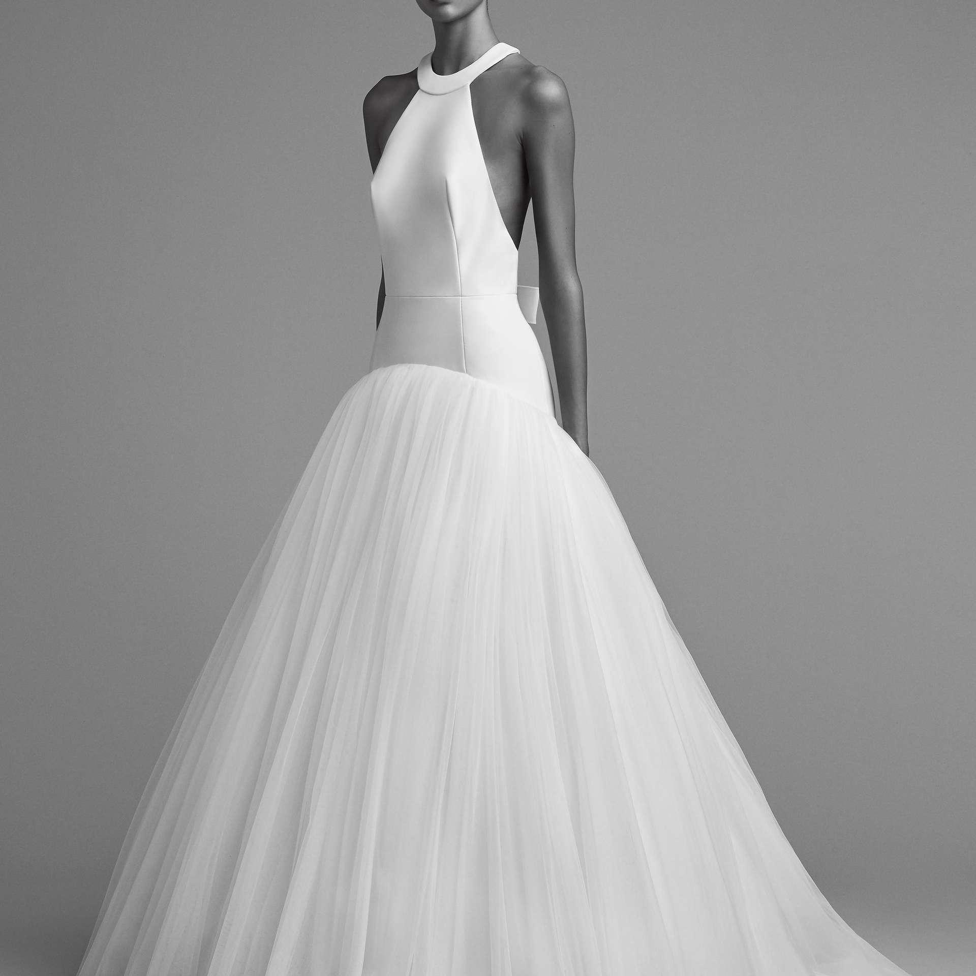 Sleeveless dramatic wedding gown