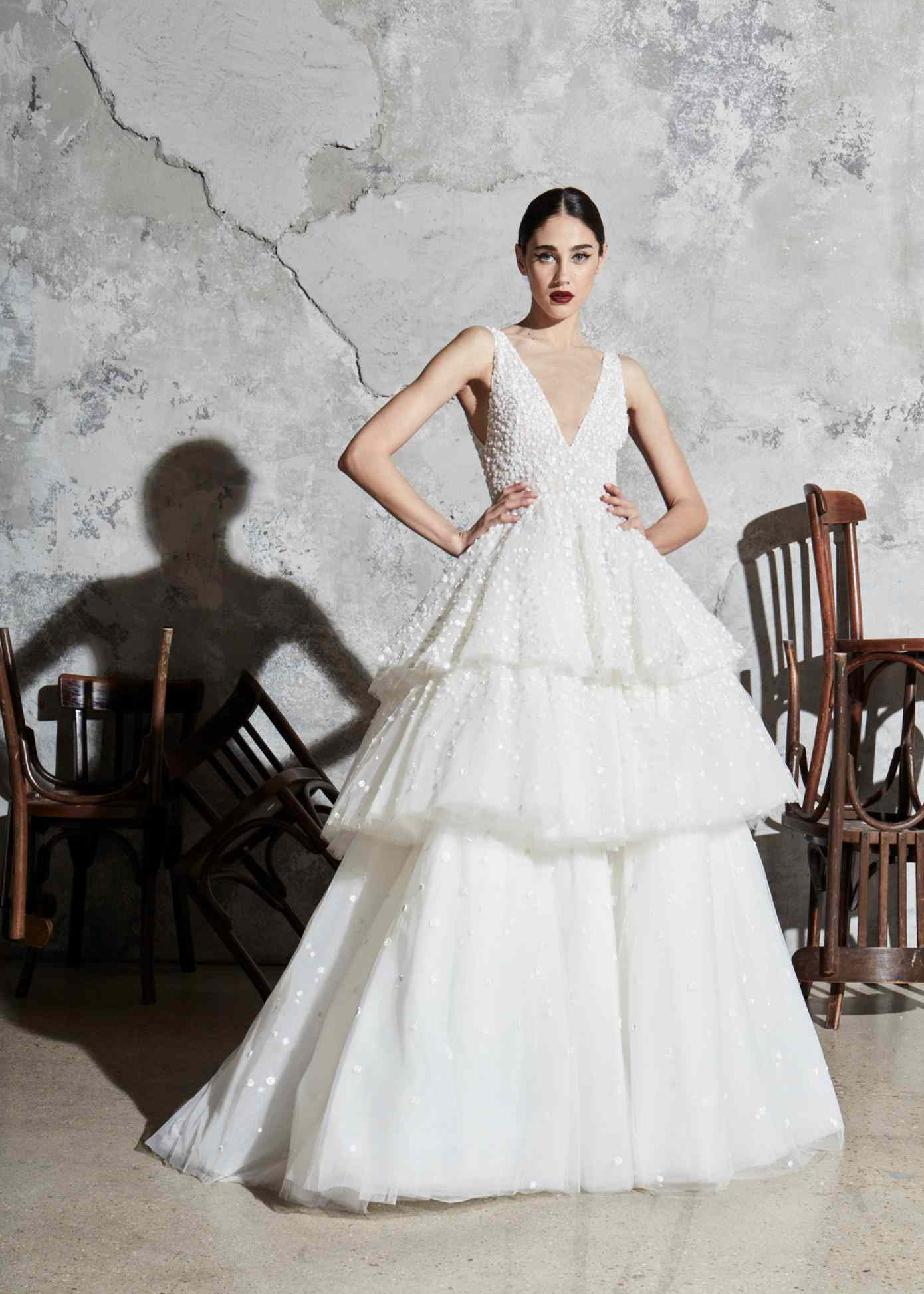 Model in V-neck ballgown with three-tiered tulle skirt with dot embroidery
