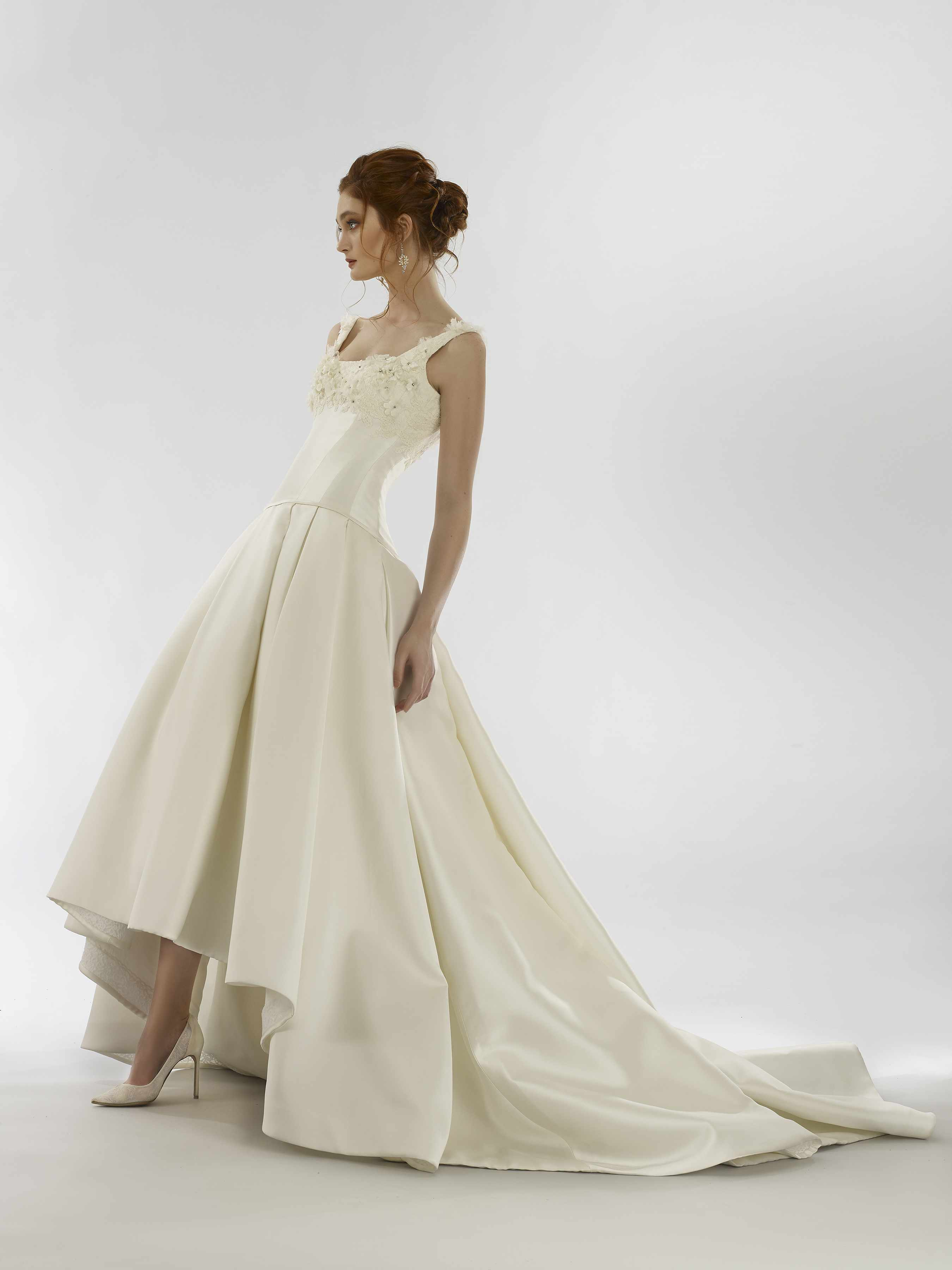 Model in high-low sleeveless ballgown with floral appliques
