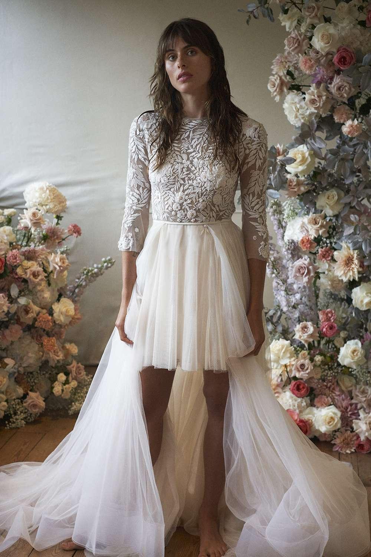 Model in three-quarter-sleeve mini dress