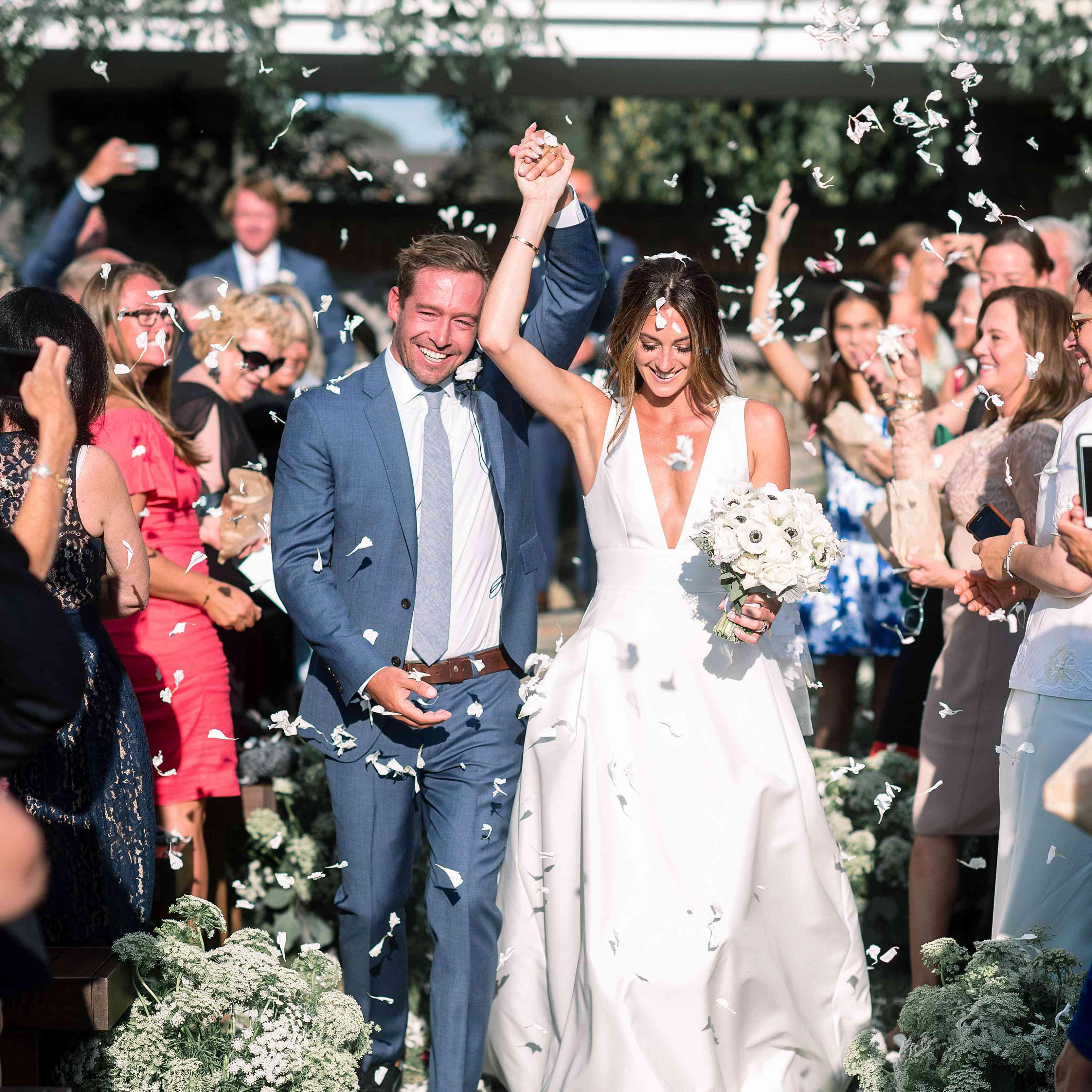 Bride and groom with white confetti