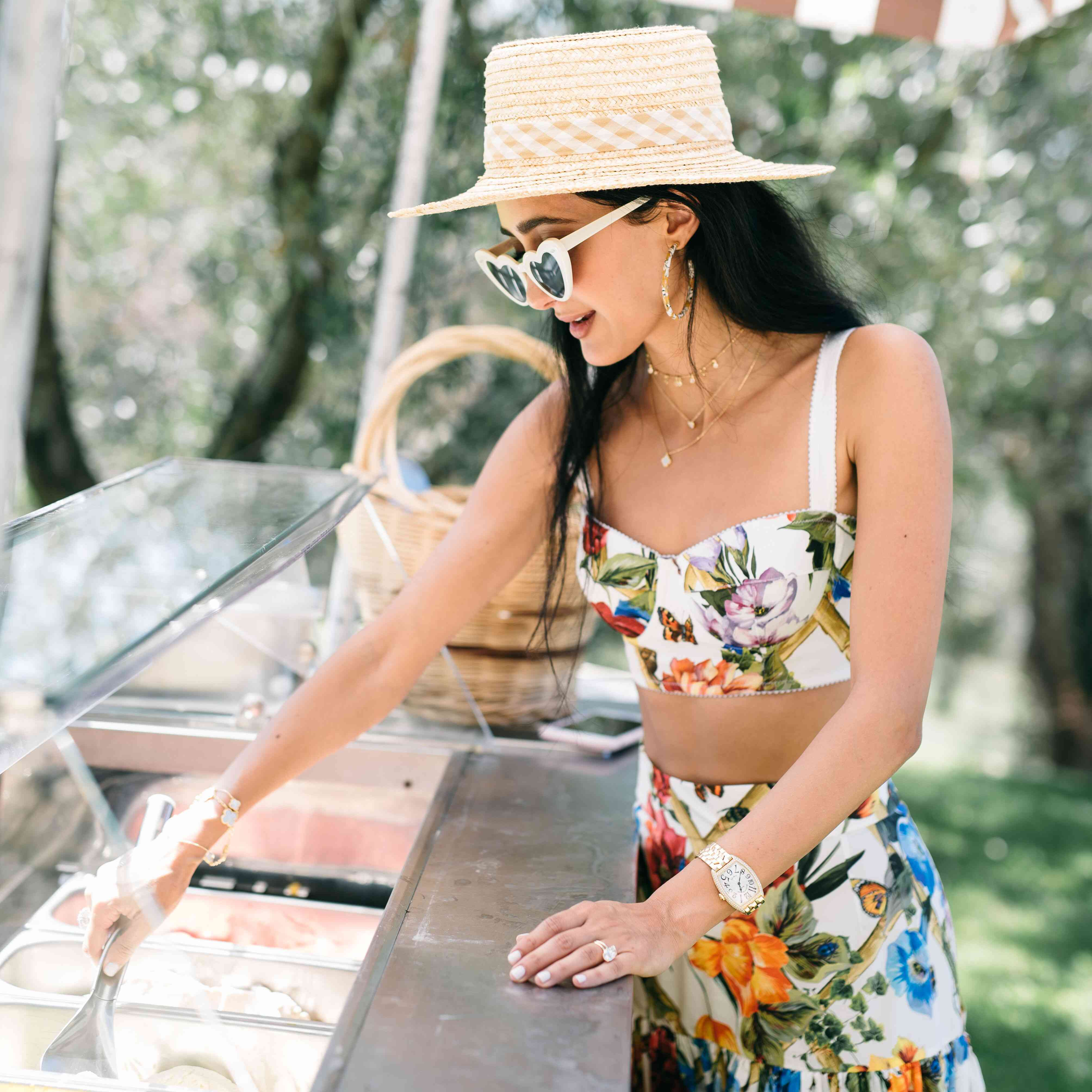 A woman scooping ice cream