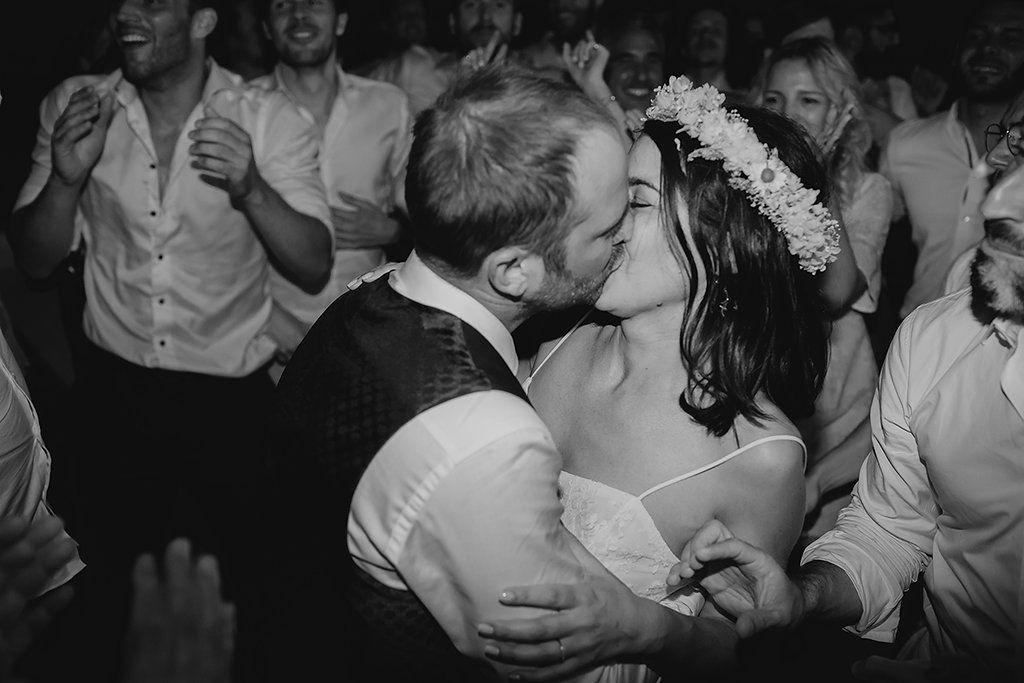 bride and groom kissing on dancefloor